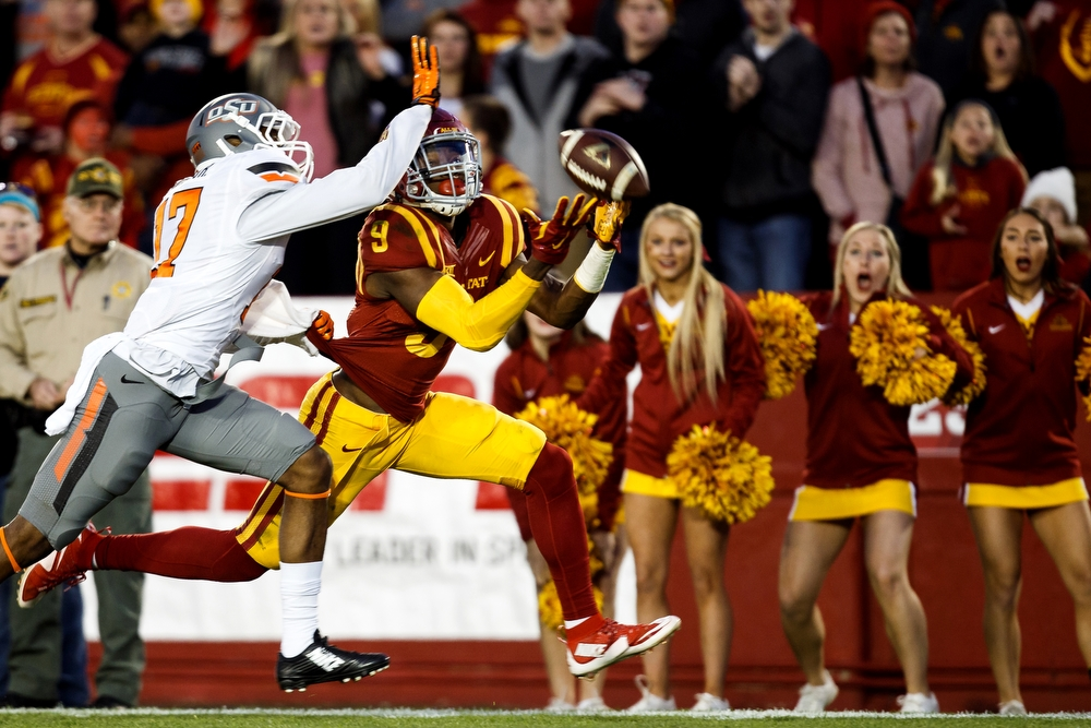 Iowa State's Quenton Bundrage can't come up with a pass as he is defended by Oklahoma State's Michael Hunter during their game at Jack Trice Stadium on Saturday, November 14, 2015 in Ames.