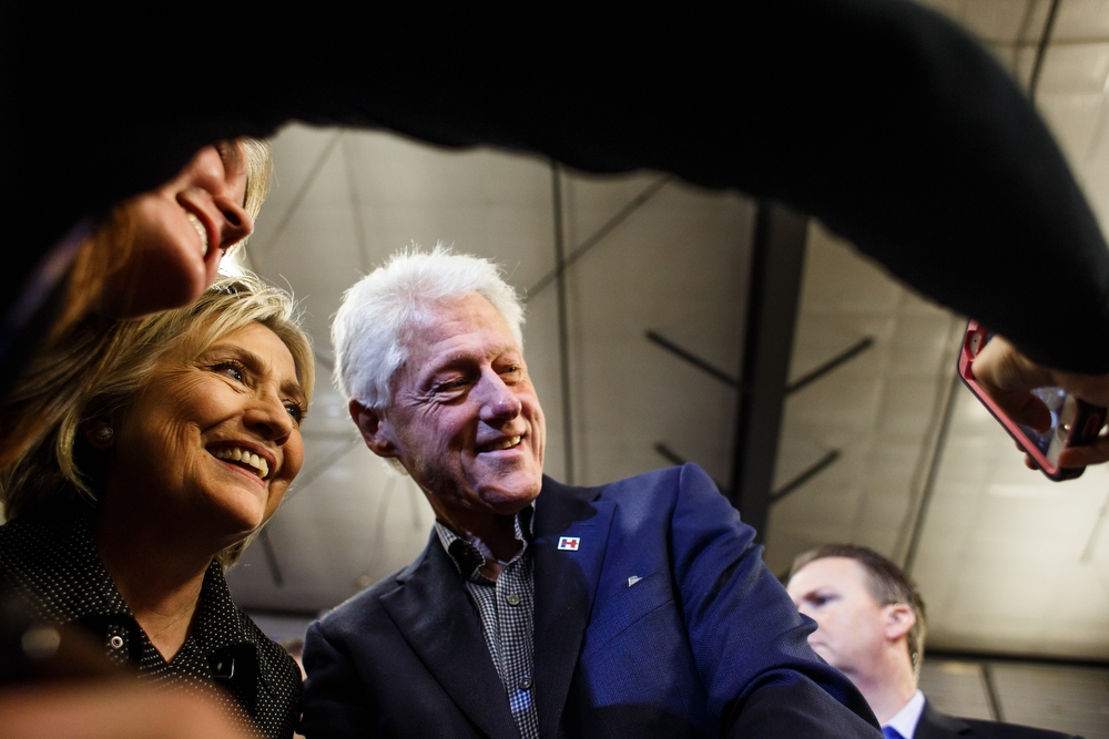 Hillary Clinton and her husband Bill take a selfie with a supporter after speaking at the Central Iowa Democrats Fall Barbecue inside the Hansen Agriculture Student Learning Center on Sunday, November 15, 2015 in Ames.