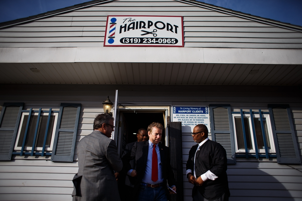 Republican presidential candidate Rand Paul walks outside after talking to residents during a campaign stop at the Hairport Barber shop on Saturday, December 05, 2015 in Waterloo.