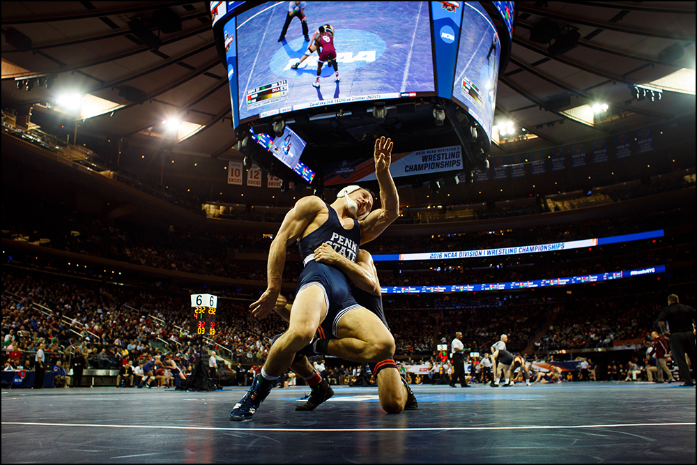 Penn State's Geno Morelli falls back on Illinois Steven Rodrigues during their second round NCAA Division I championship bout on Thursday, March 17, 2016 in New York City, New York.