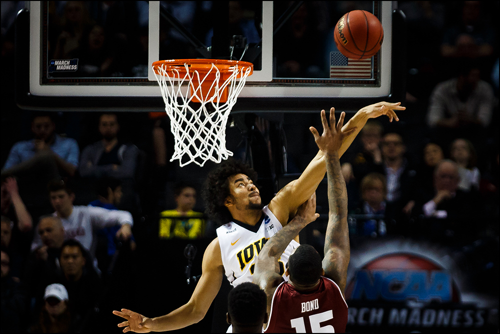 Iowa's Dom Uhl (25) blocks a shot during their first round NCAA championship game on Friday, March 18, 2016 in New York City,New York.