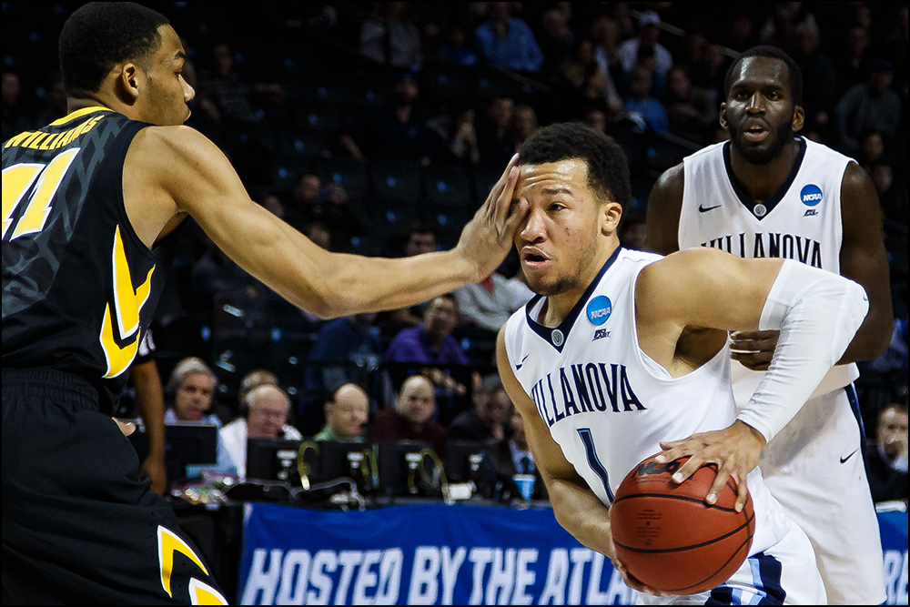Iowa's Christian Williams (11) defends Villanova's Jalen Brunson during their second round NCAA Basketball Championship game on Sunday, March 20, 2016 in New York City, New York.