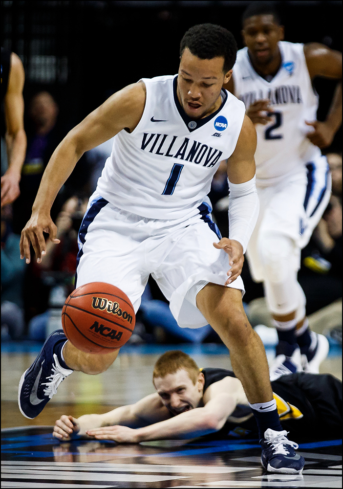 Villanova's Jalen Brunson takes off down the court away from from Iowa's Mike Gesell (10) during their second round NCAA Basketball Championship game on Sunday, March 20, 2016 in New York City, New York.