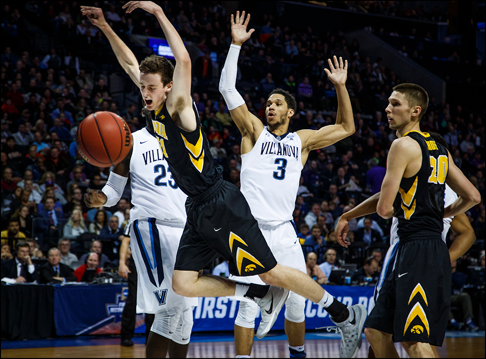 Iowa's Nicholas Baer (51) is fouled on his way to the basket during their second round NCAA Basketball Championship game on Sunday, March 20, 2016 in New York City, New York. Villanova would go on to win 87-68.