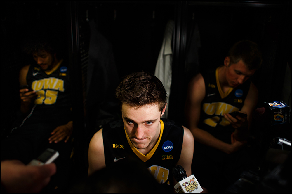 Iowa's Nicholas Baer (51) talks to the media in the locker room following their 87-68 loss to Villanova during their second round NCAA Basketball Championship game on Sunday, March 20, 2016 in New York City, New York.