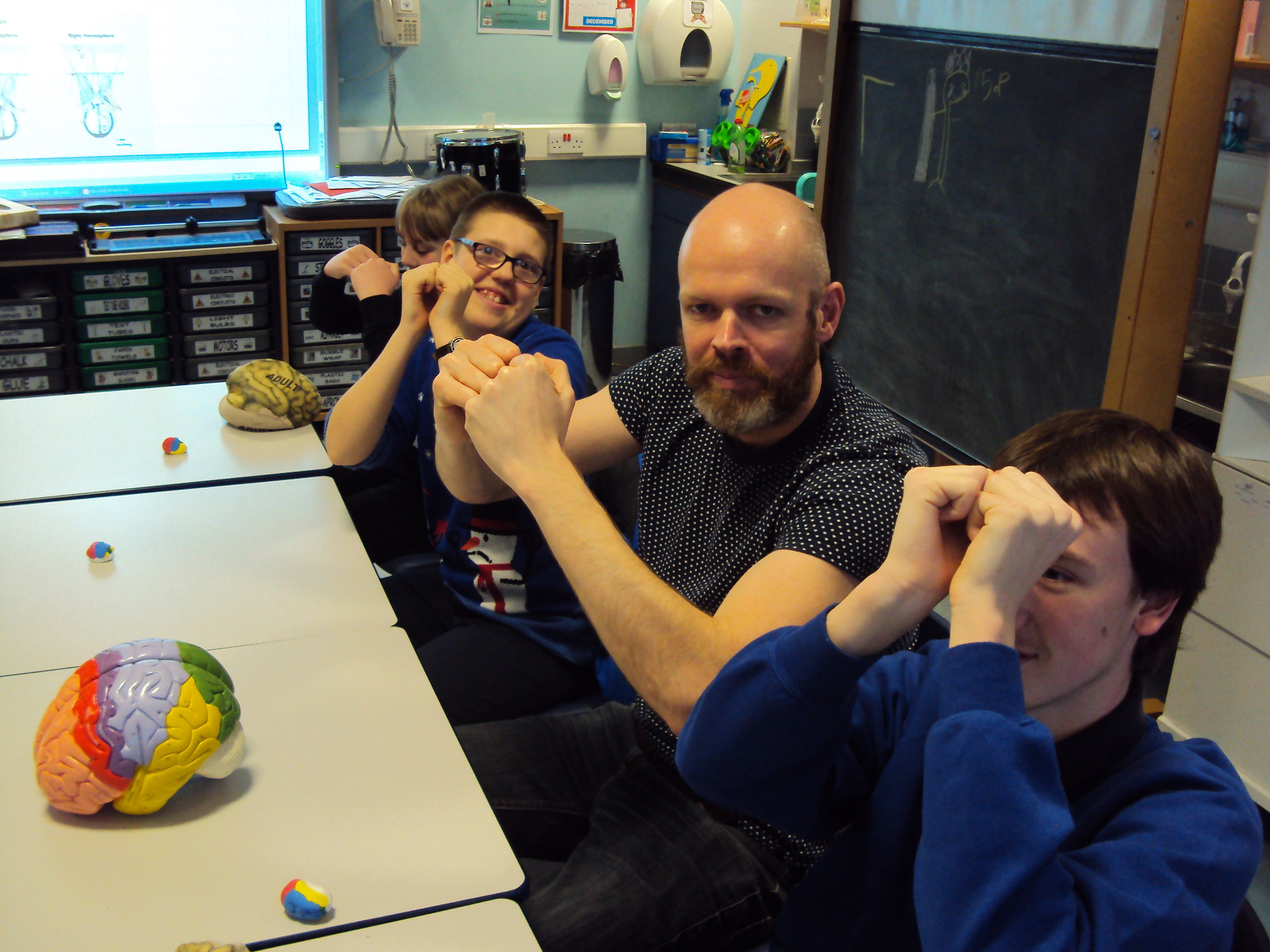 Pupils and support staff at Saltersgate showing off the size of the their brains!!