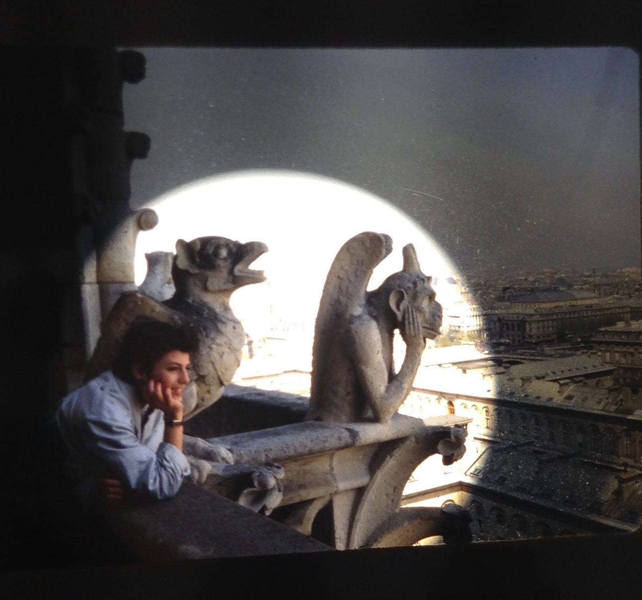 1985. Looking out from high atop Notre Dame Cathedral, my first visit to Paris. (This is from a 35mm slide exposed to a light bulb.)  I'm the one on the left. Lol.