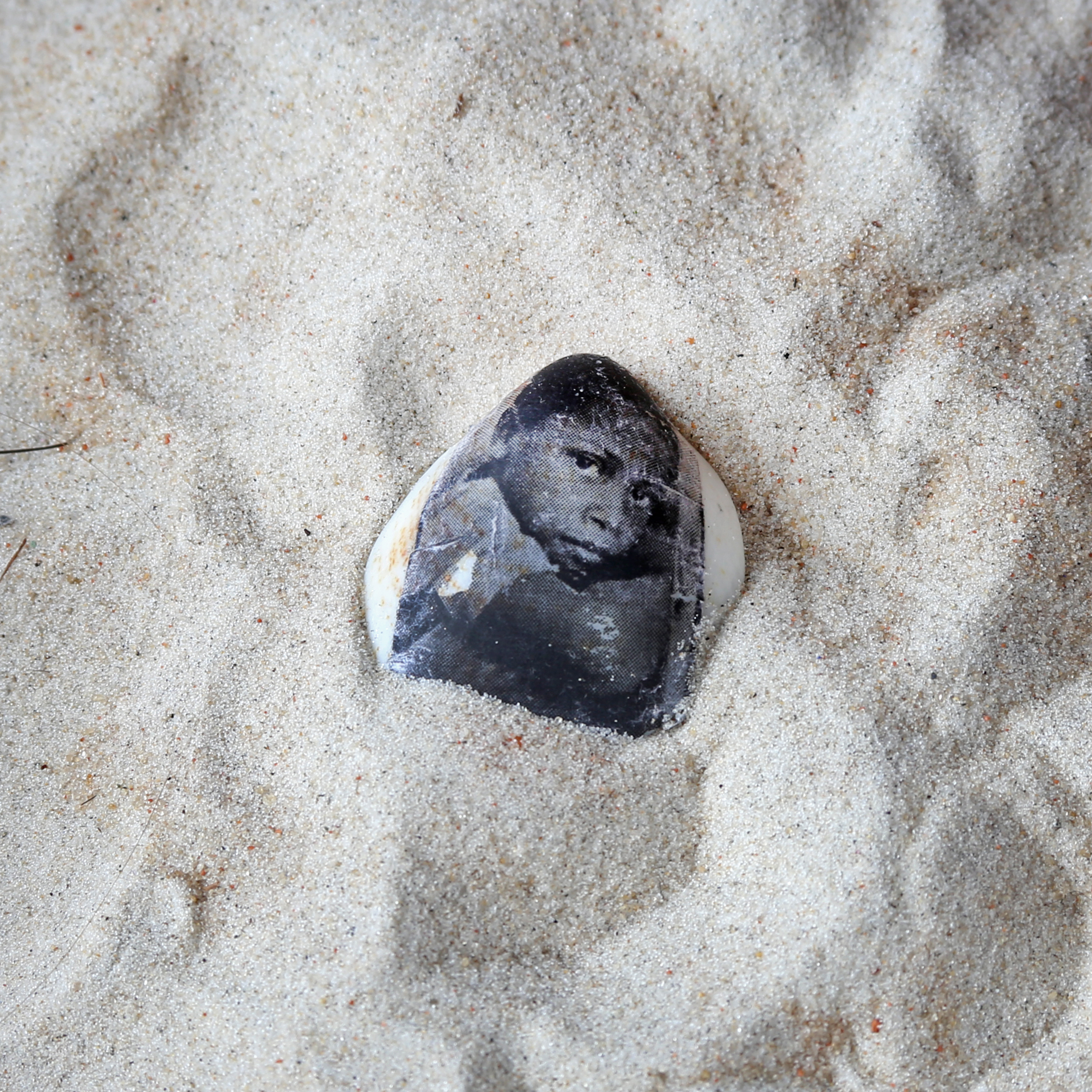 Printing on seashells found in the village of this little boy