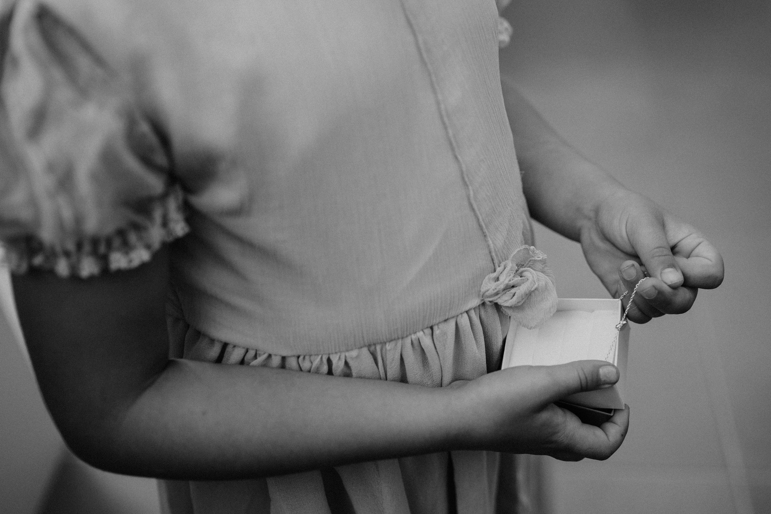 Details of Pearl's dress with a little silk flower tucked into the waist.