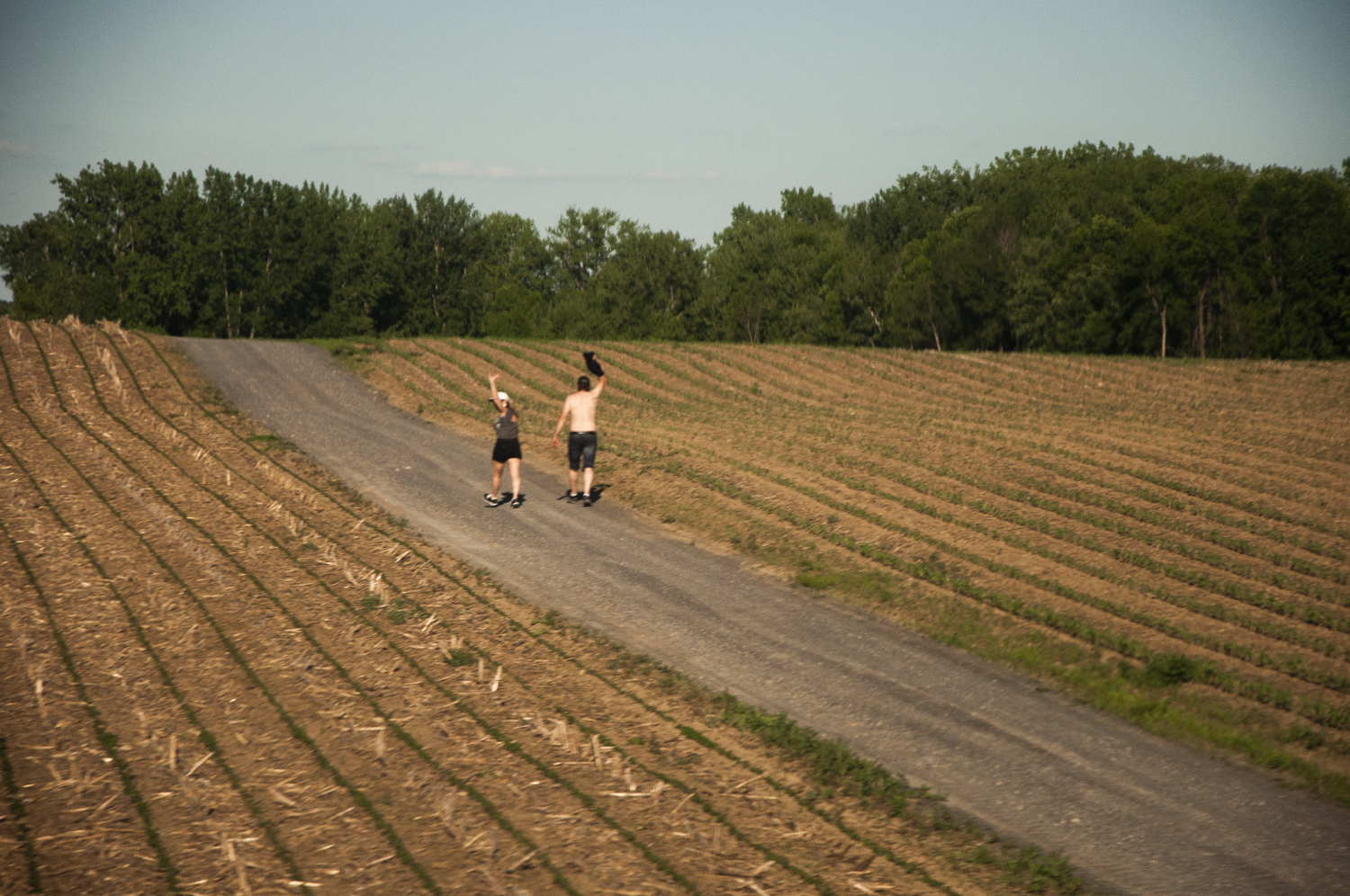 I wanted to get a photo of this couple walking down the road. Ironically, the moment I lifted the camera to shoot, they raised their arms to wave. Go figure…