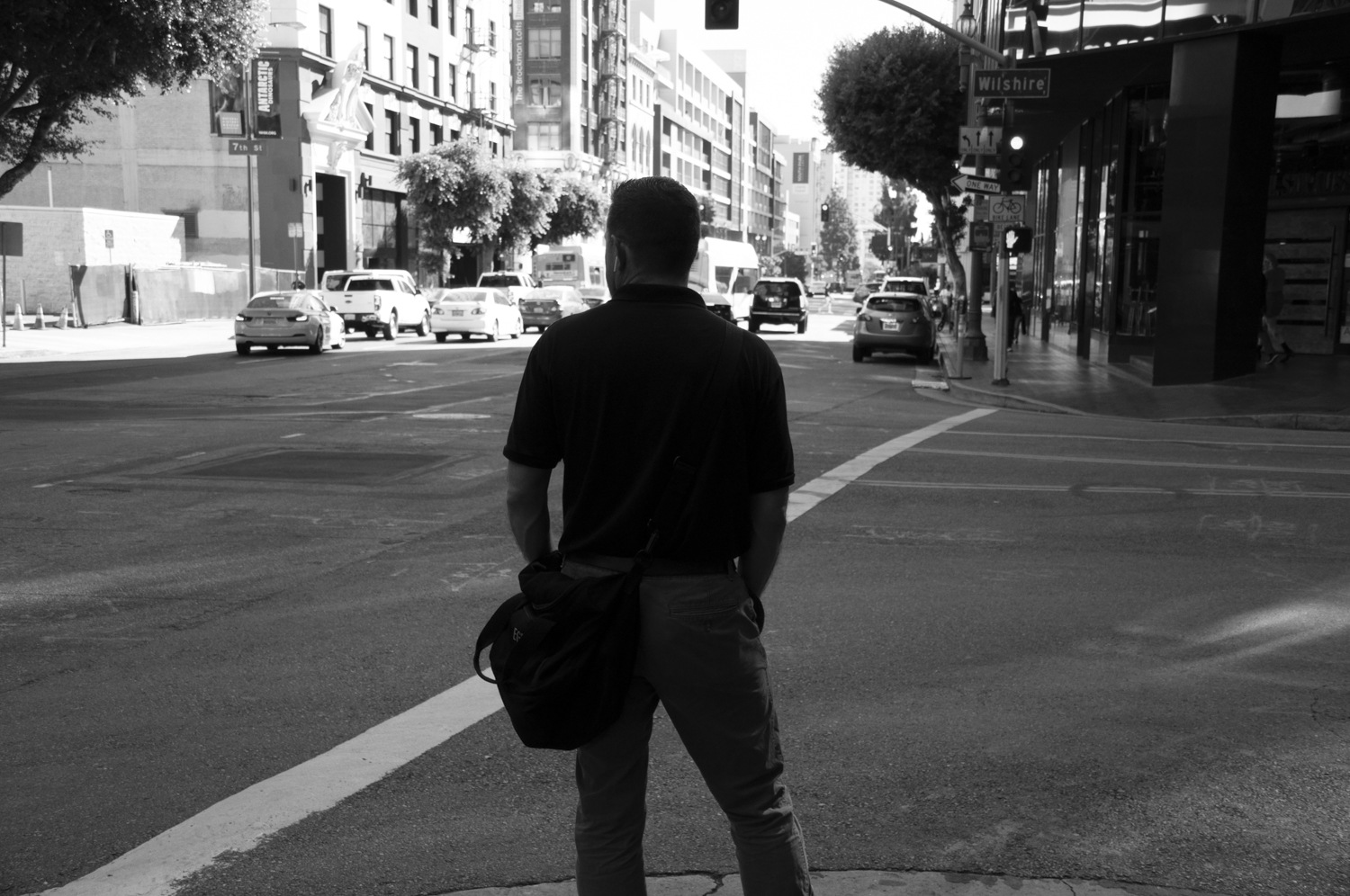 This is image is proof that I've watched The Dark Knight a lot. I couldn't pass up an image of a man standing at an urban street corner…