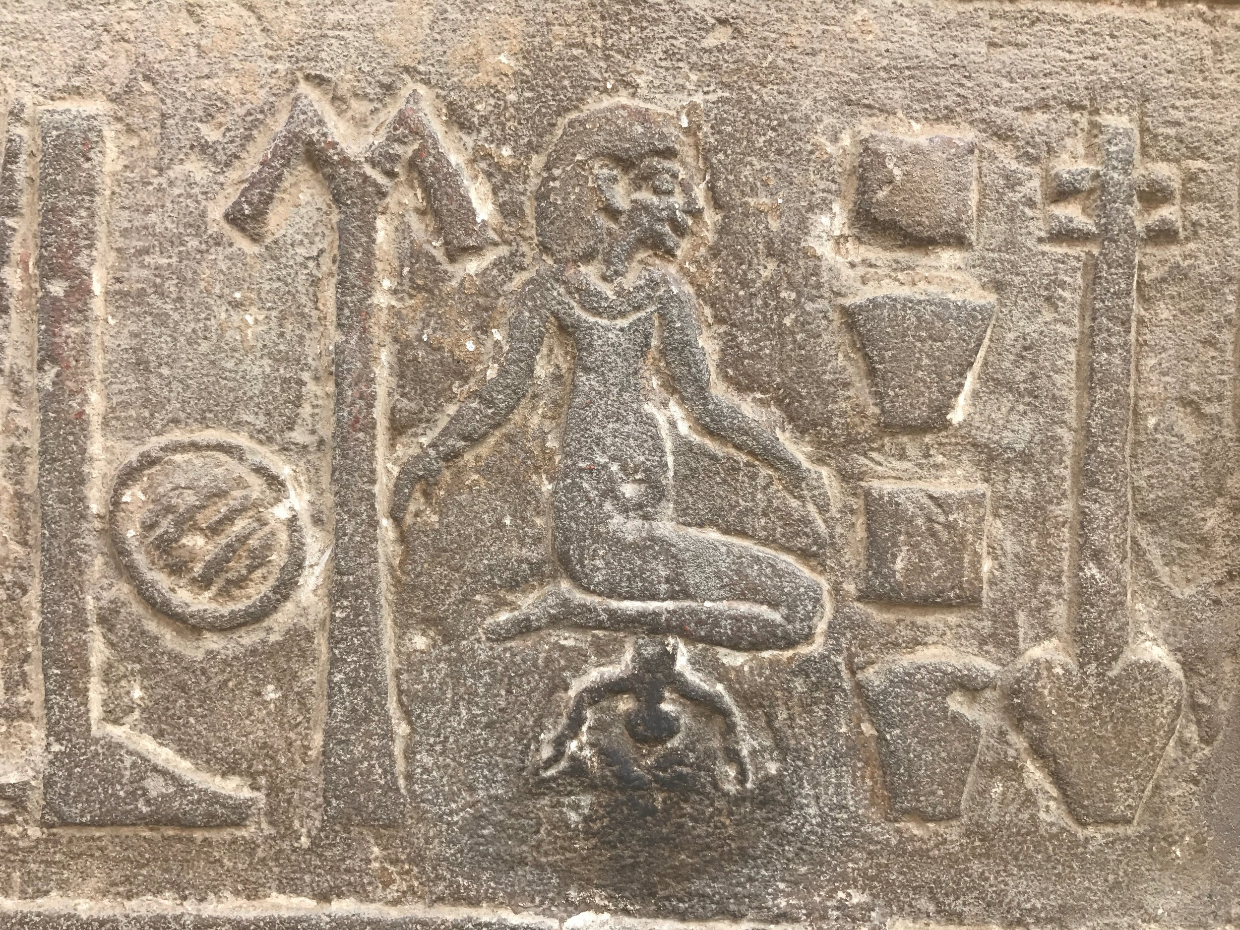 Woman squatting to give birth, on wall of ancient Egyptian temple at Kom Ombo.
