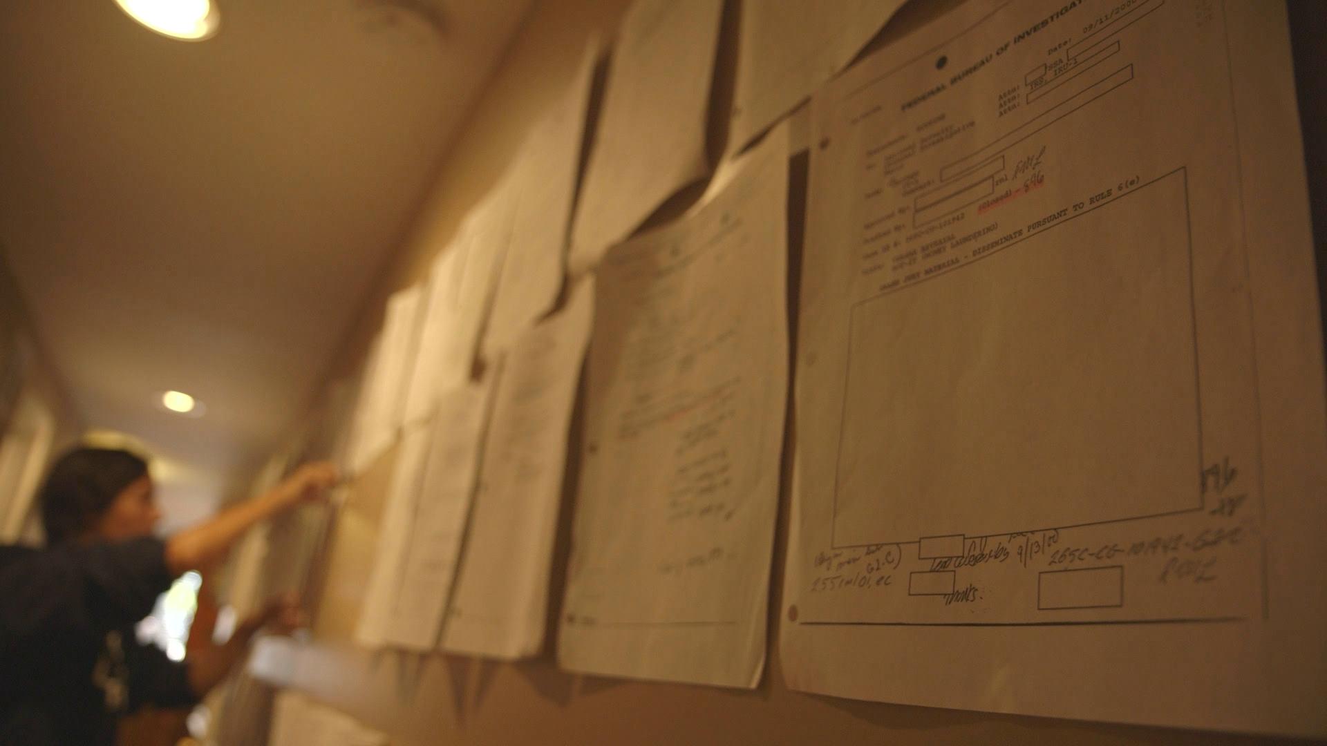 FOBW Stills_Assia hanging documents 03.jpg