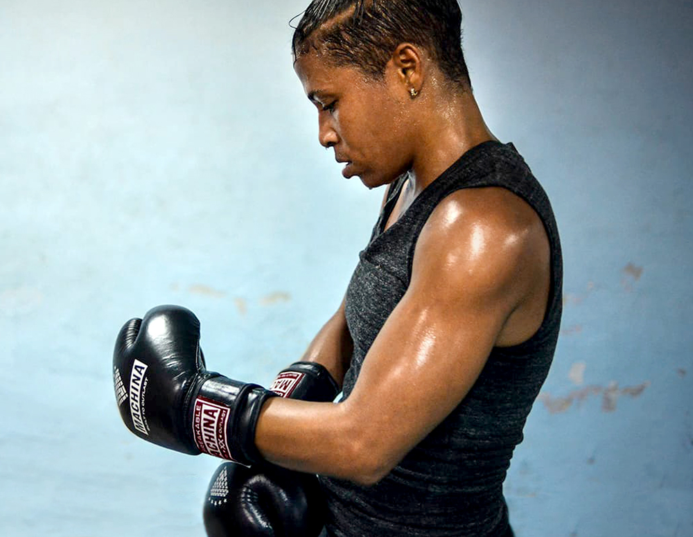 Namibia Flores strapping on her... yes! those are Machina boxing gloves!