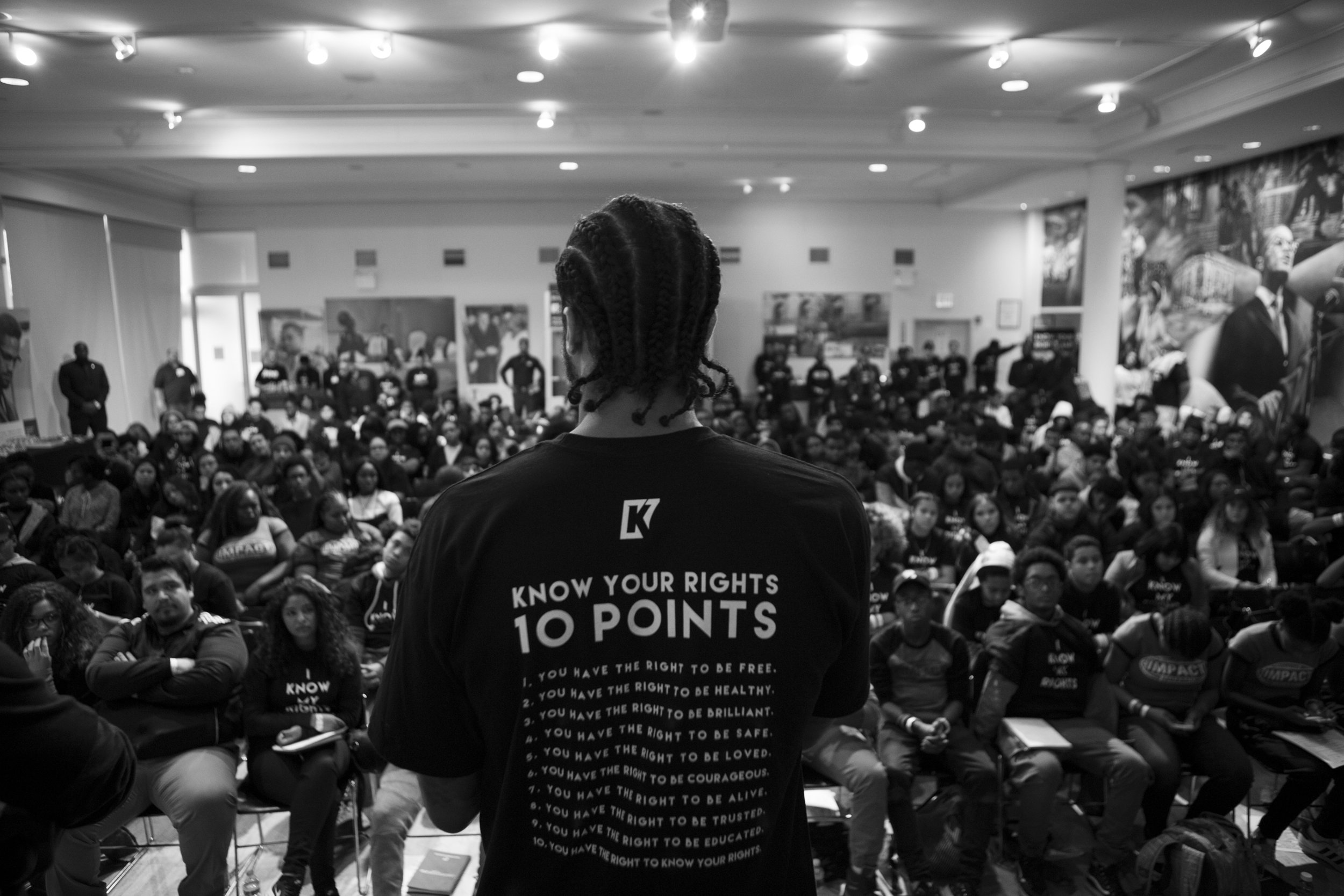 """Colin Kaepernick  speaking to attendees of  """"Know Your Rights Camp NYC""""  at the Malcolm X & Dr. Betty Shabazz Memorial & Education Center in Washington Heights."""