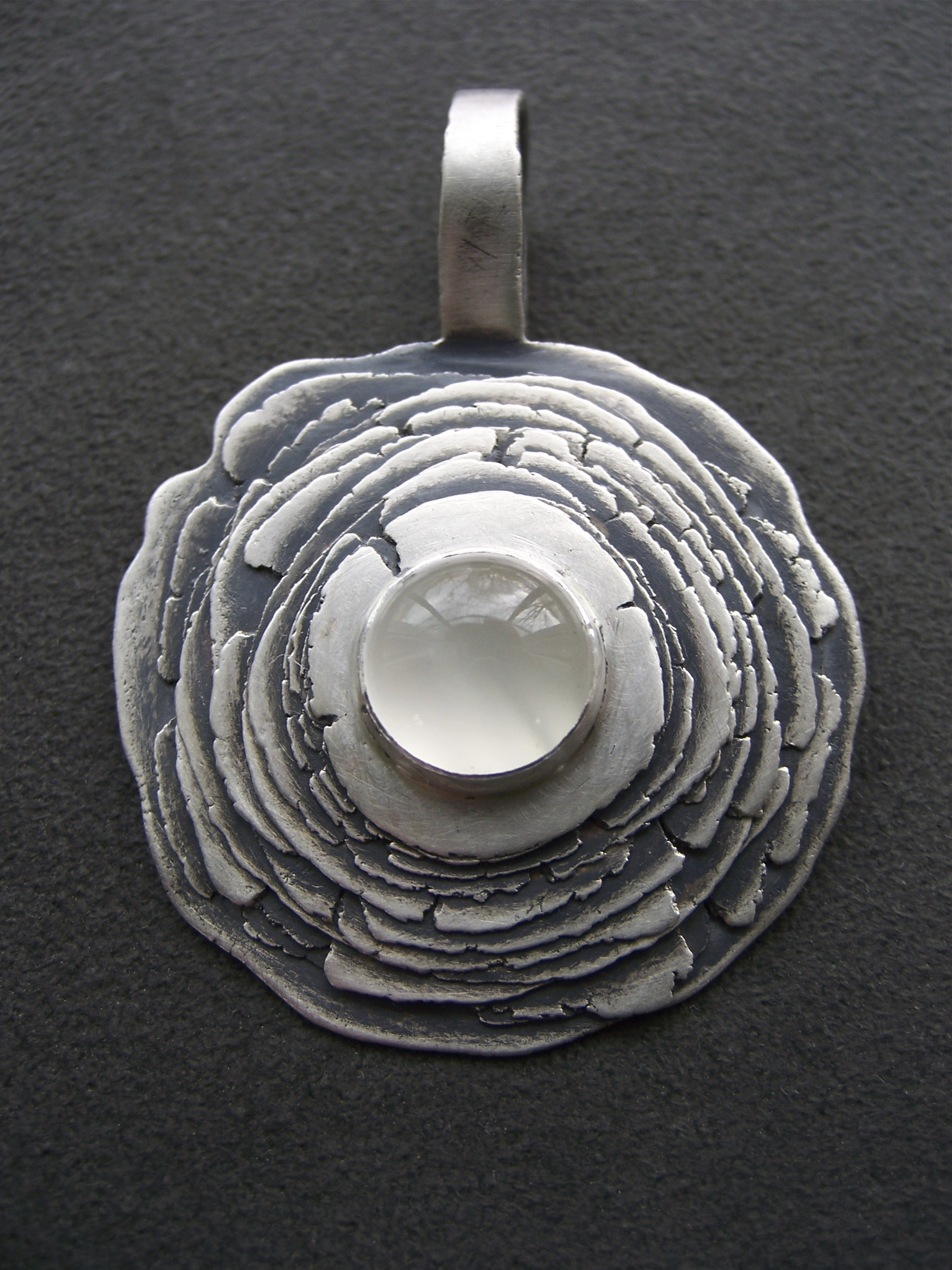 layered disc pendant with moonstone.JPG