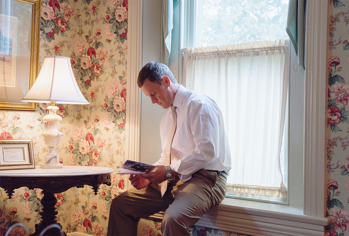 Groom reading a letter from his bride at Ceresville Mansion