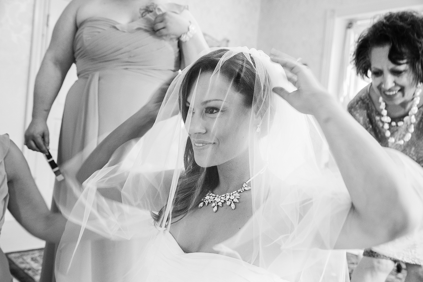 Bride putting her veil on in the getting ready rooms at Ceresville Mansion
