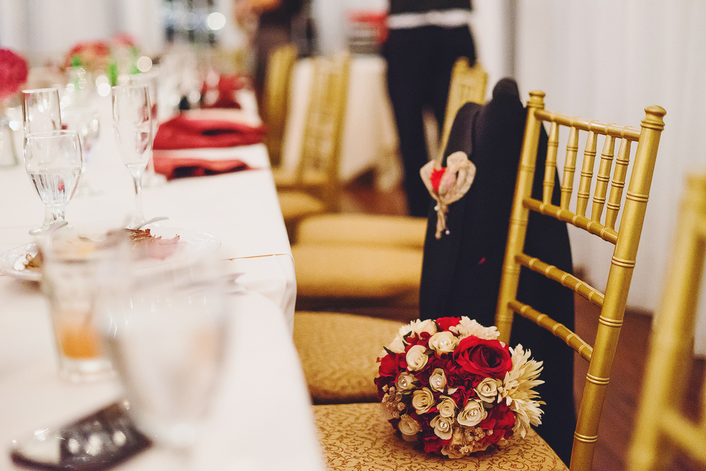 Table decor and rose bouquet at Bristow Manor wedding