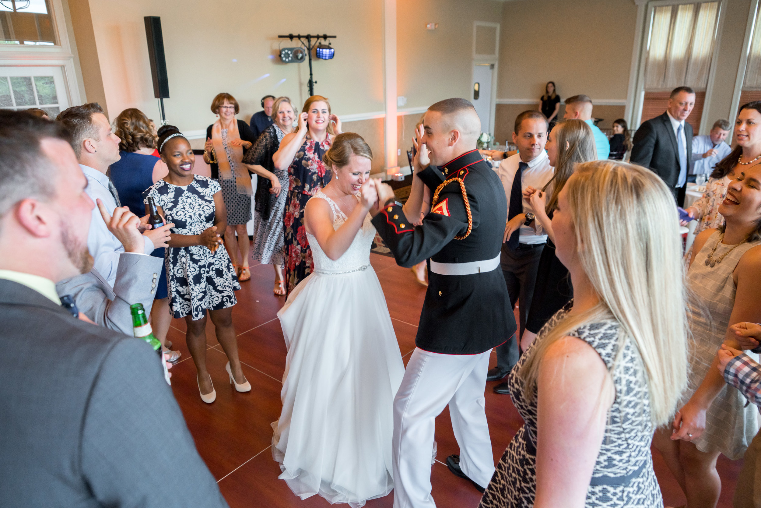 Bride and groom on the dance floor in a circle of friends