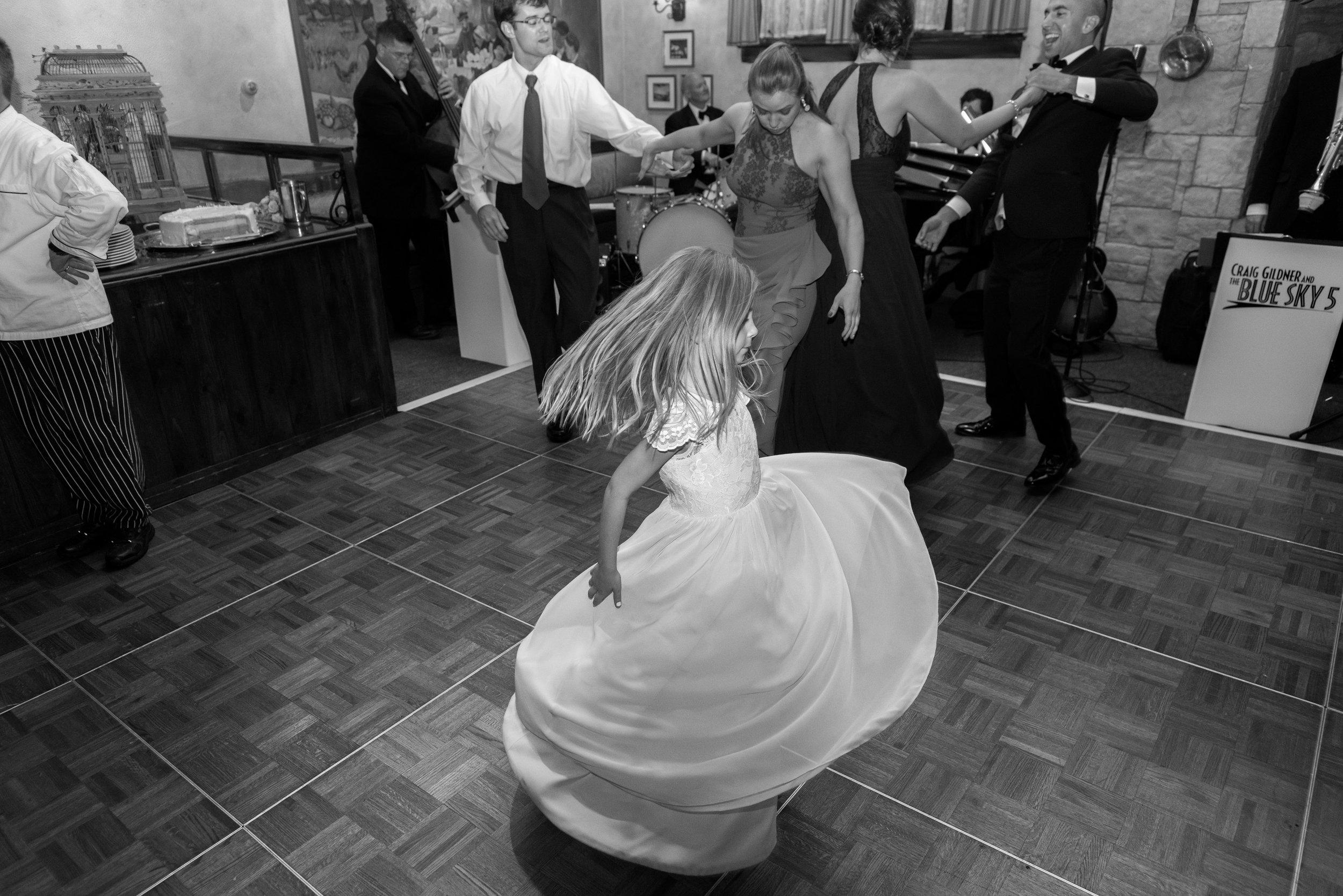 Flower girl twirling on the dance floor at La Ferme