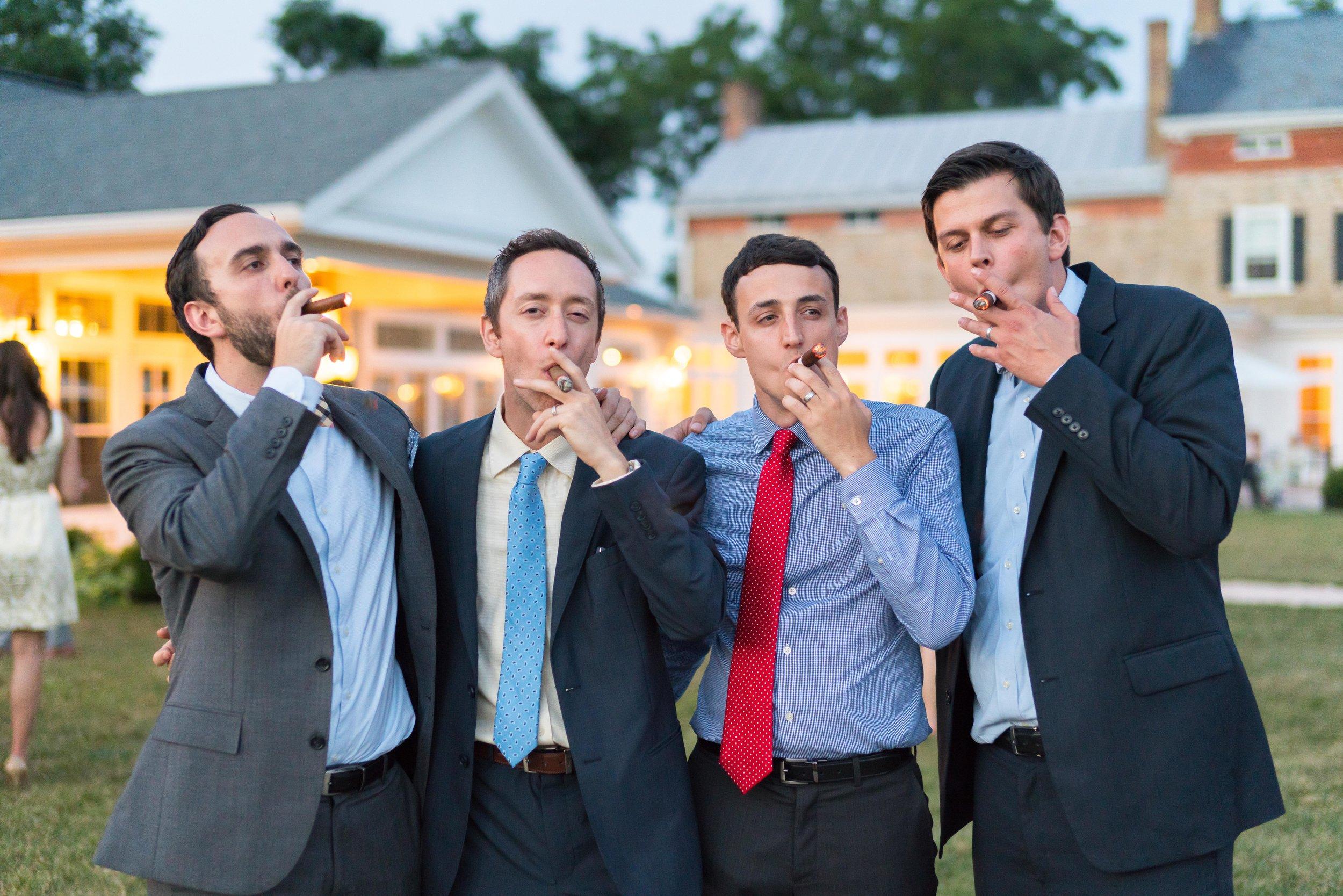 Groomsmen photo smoking cigars at Springfield Manor