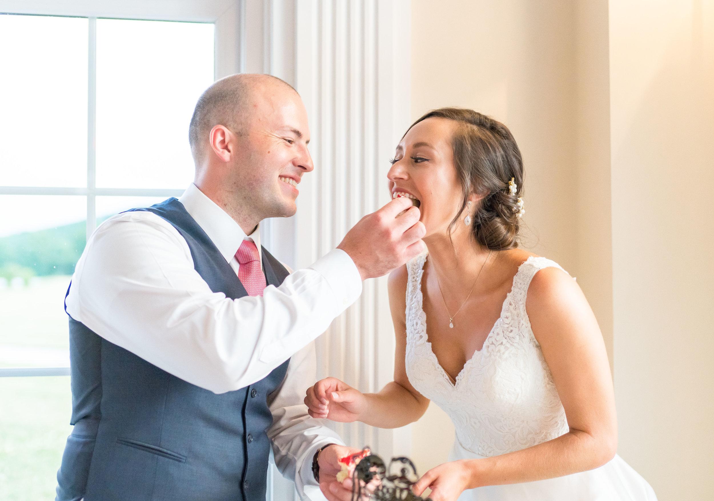 Bride and groom cutting cake in a beautiful ballroom