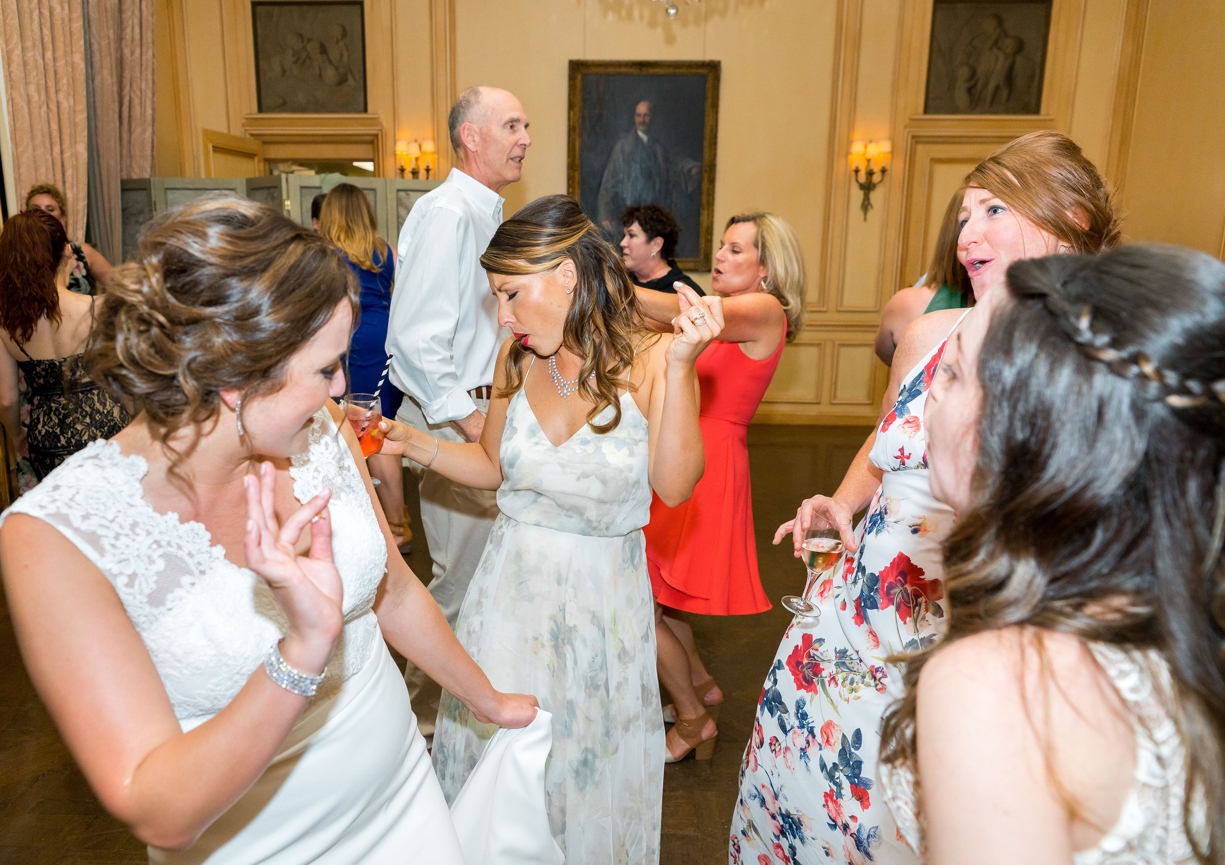 Maid of Honor and bride at wedding reception at Meridian House