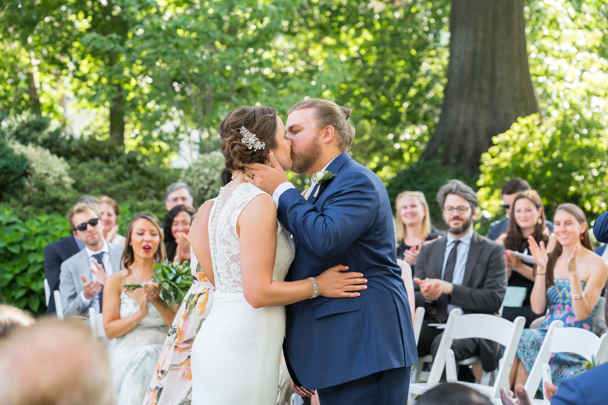 Bride and groom wedding ceremony kiss at meridian house