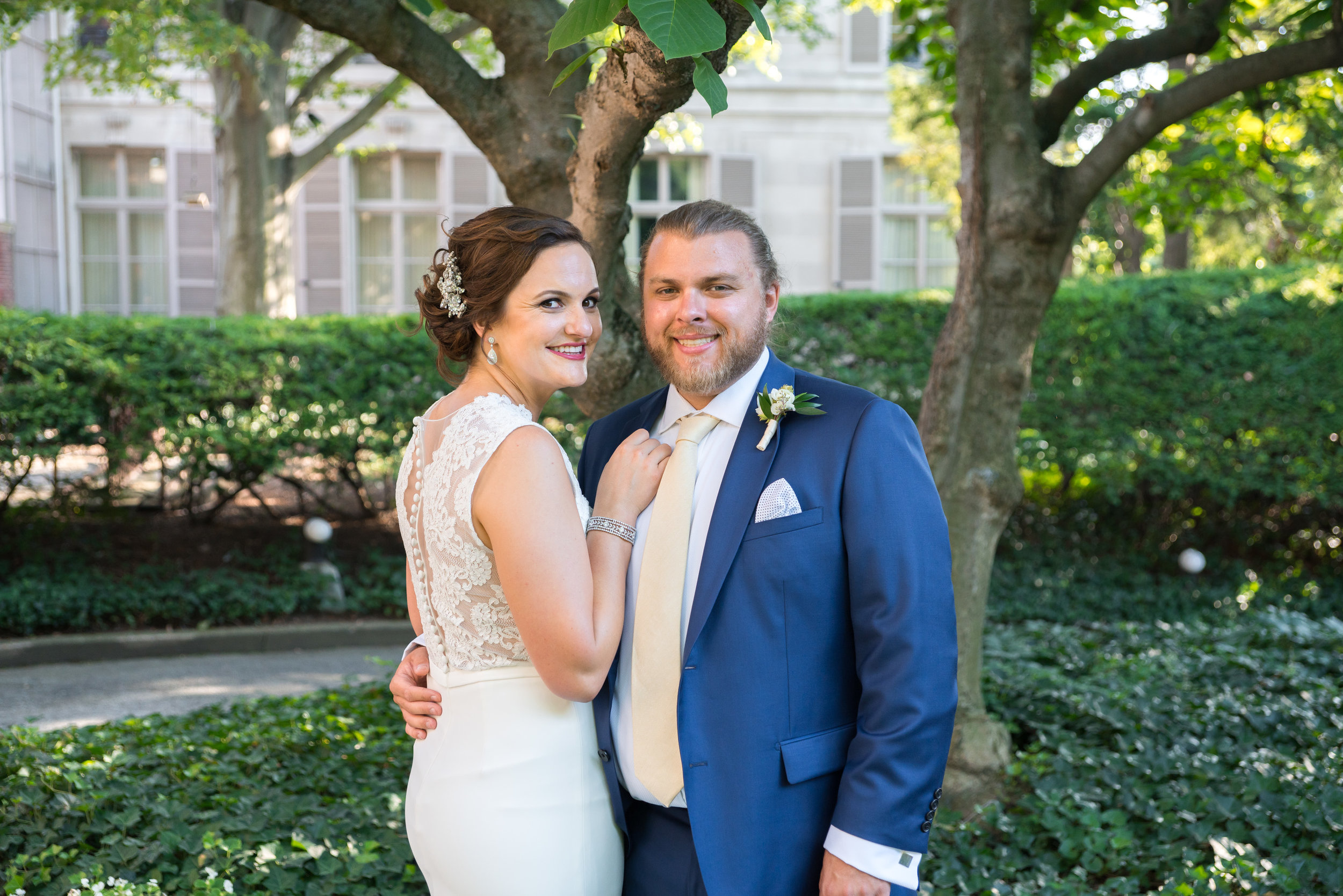BRide and groom at a summer wedding at meridian house