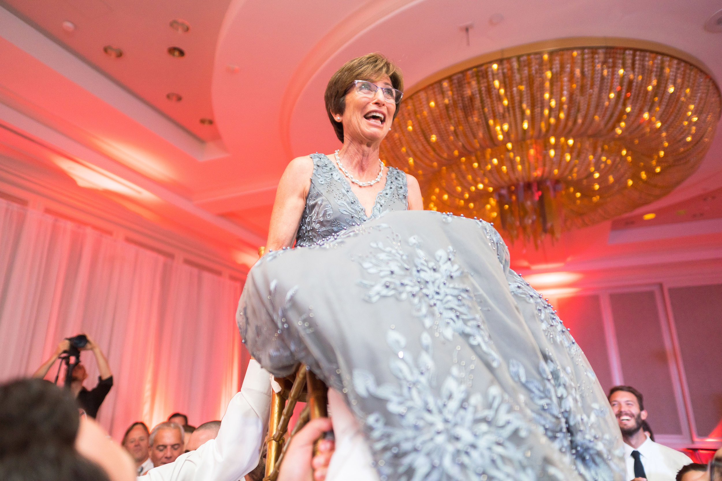 Jewish wedding photos hora chairs