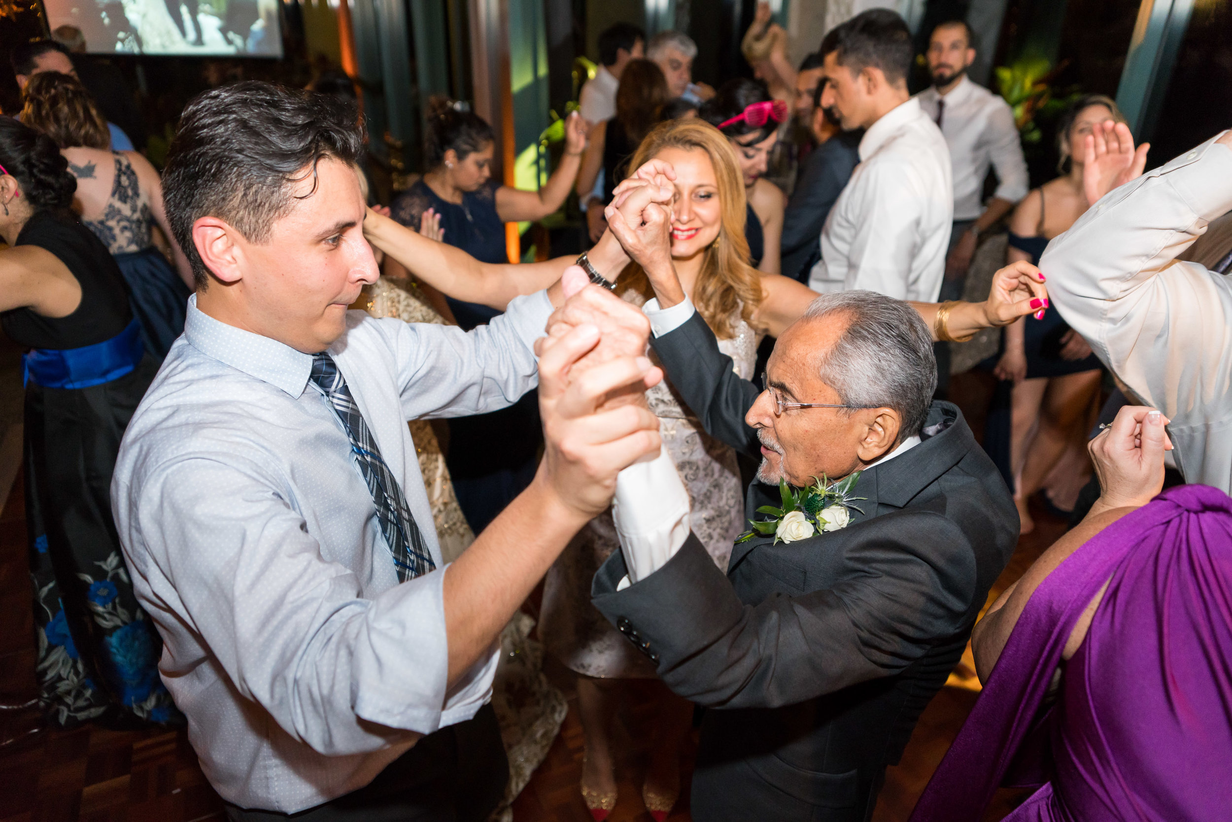 groom and dad dancing at meadowlark wedding