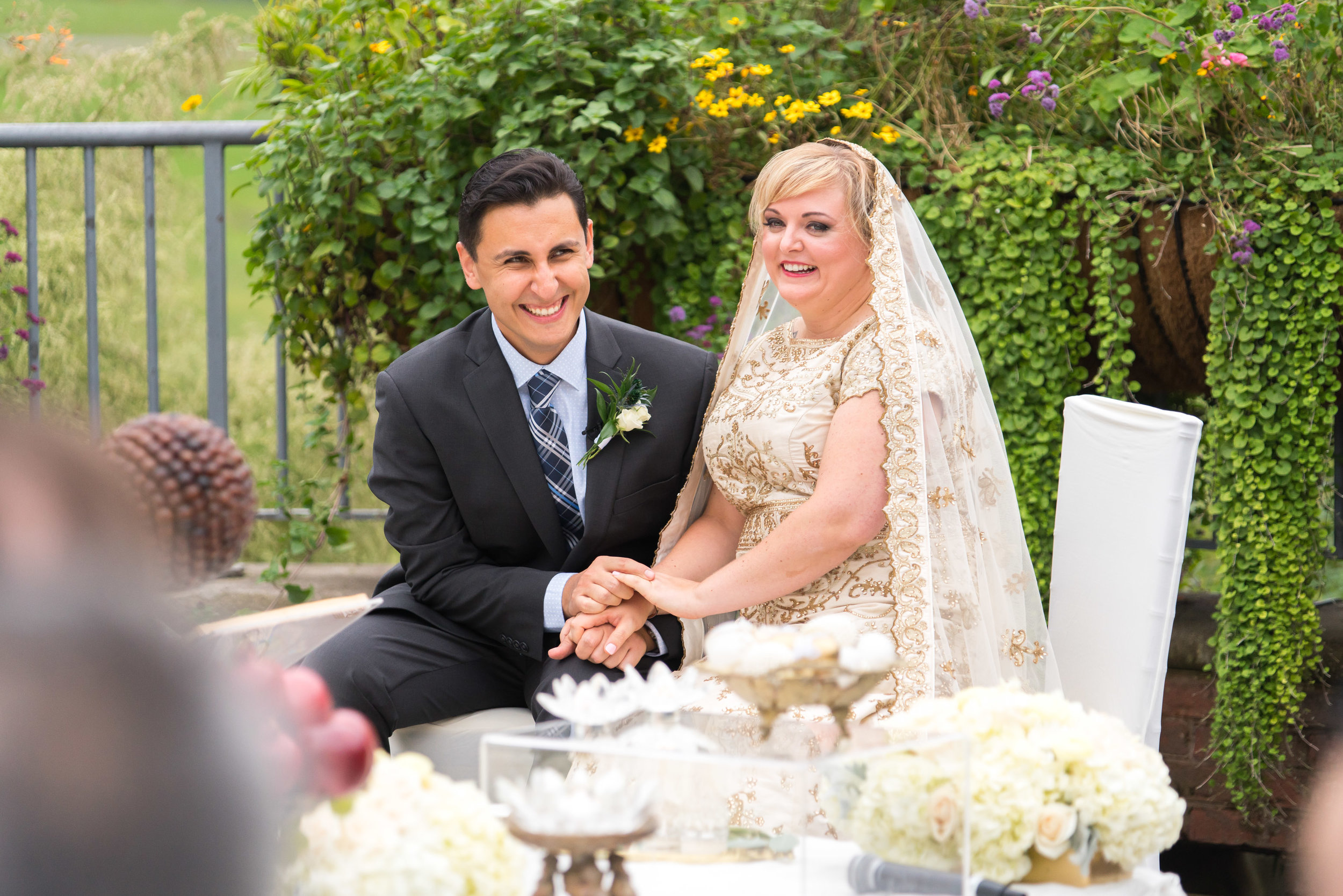 Persian ceremony in front of sofreh at meadowlark gardens