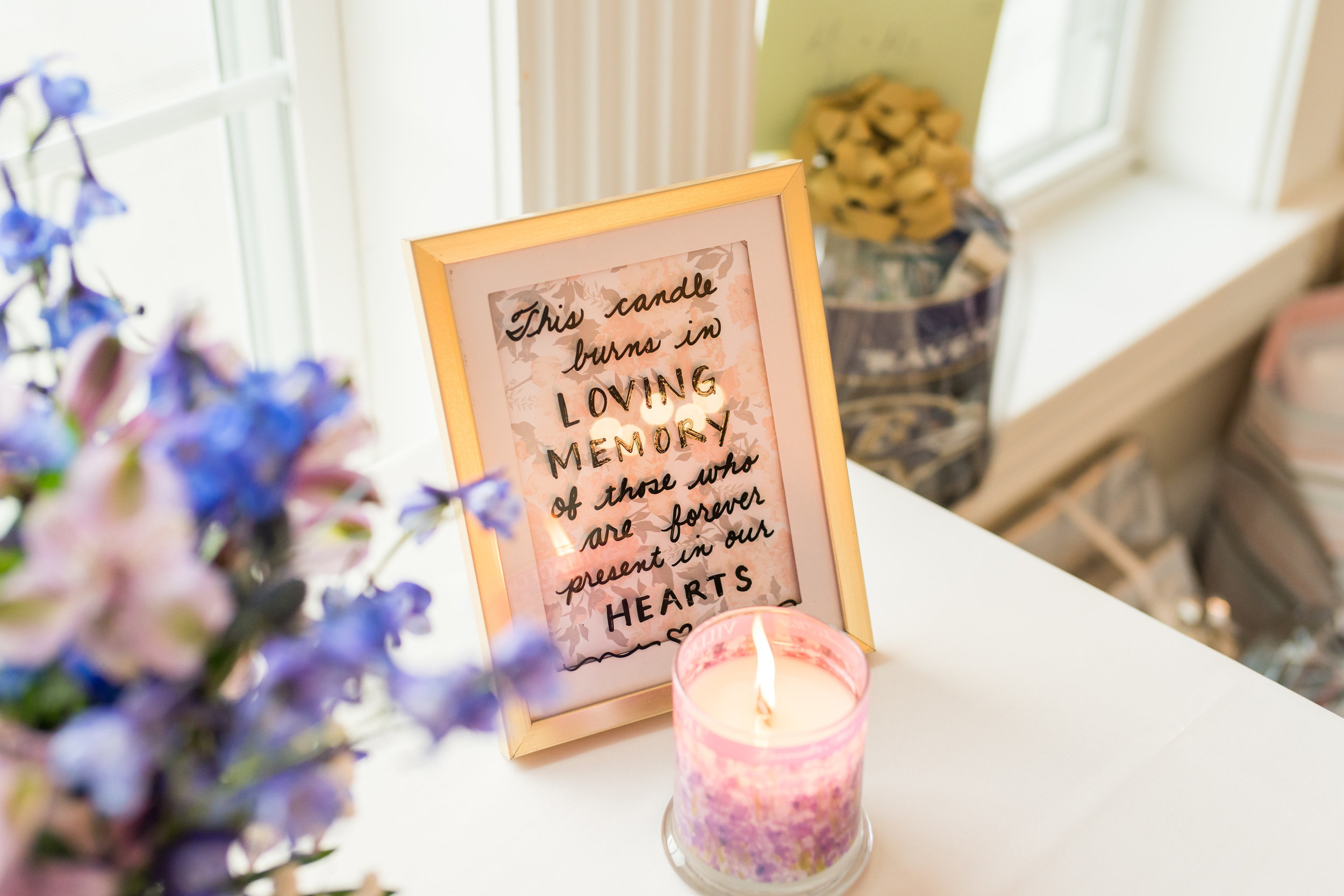 Memorial candle at wedding reception table