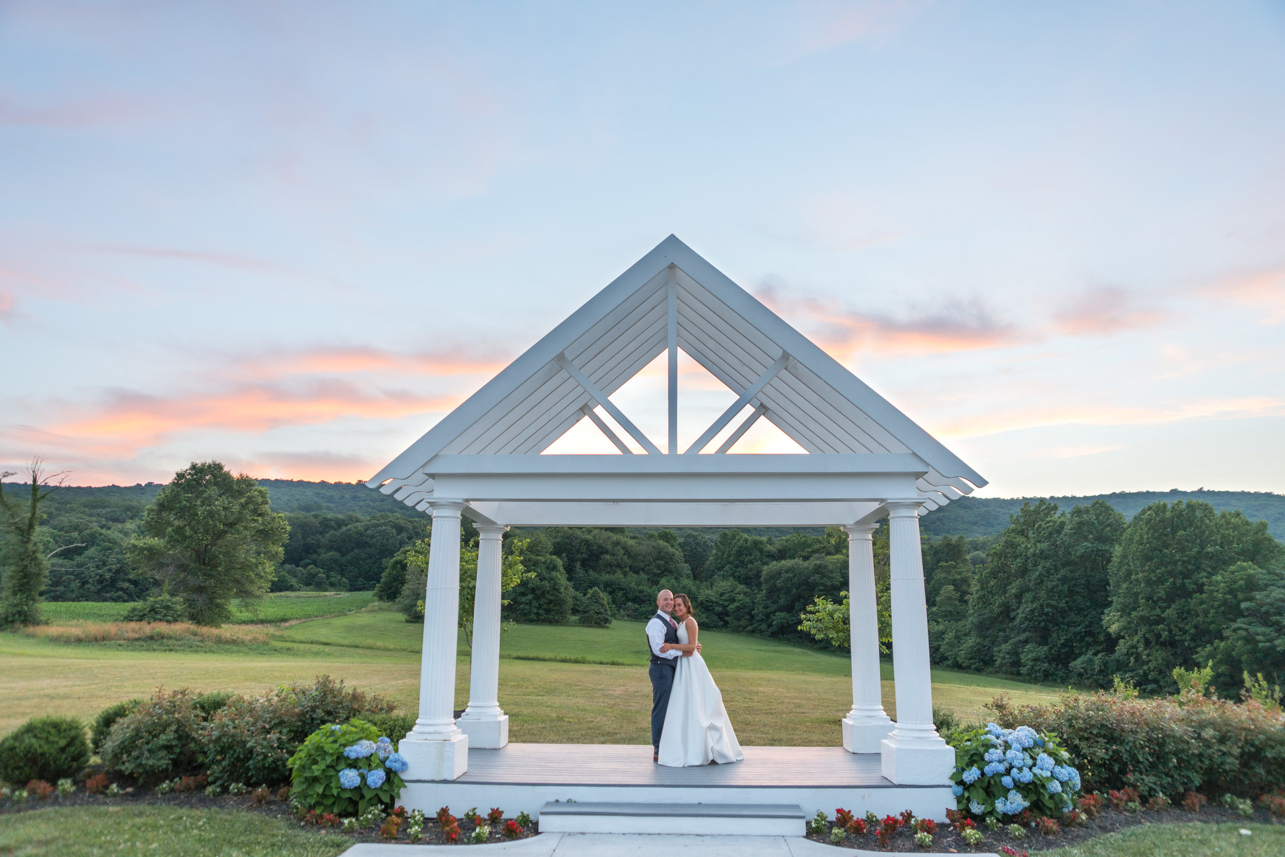 Beautiful bride and groom at sunset at Springfield Manor Vineyard and Winery