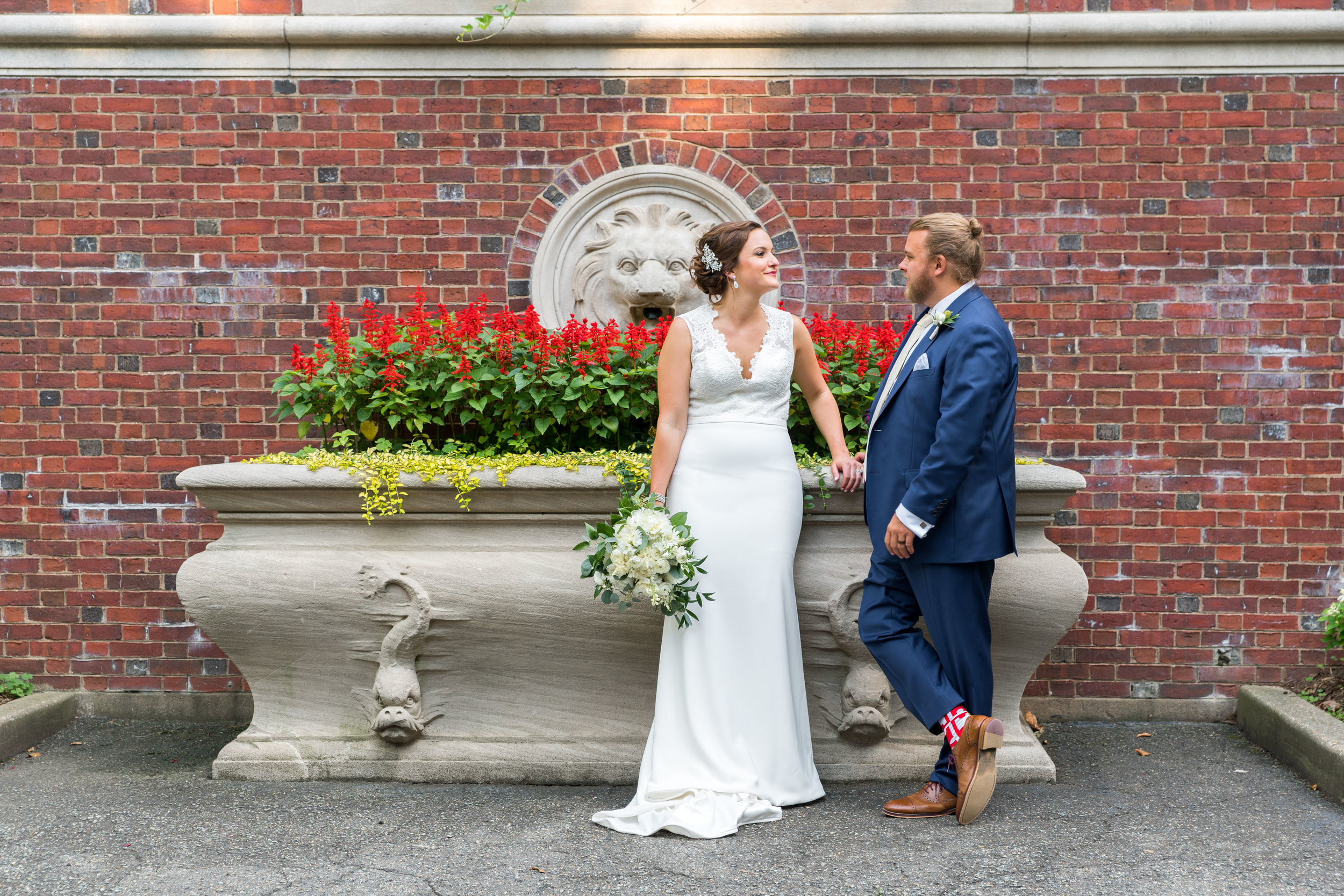 Wedding ortraits by a brick wall next to meridian house