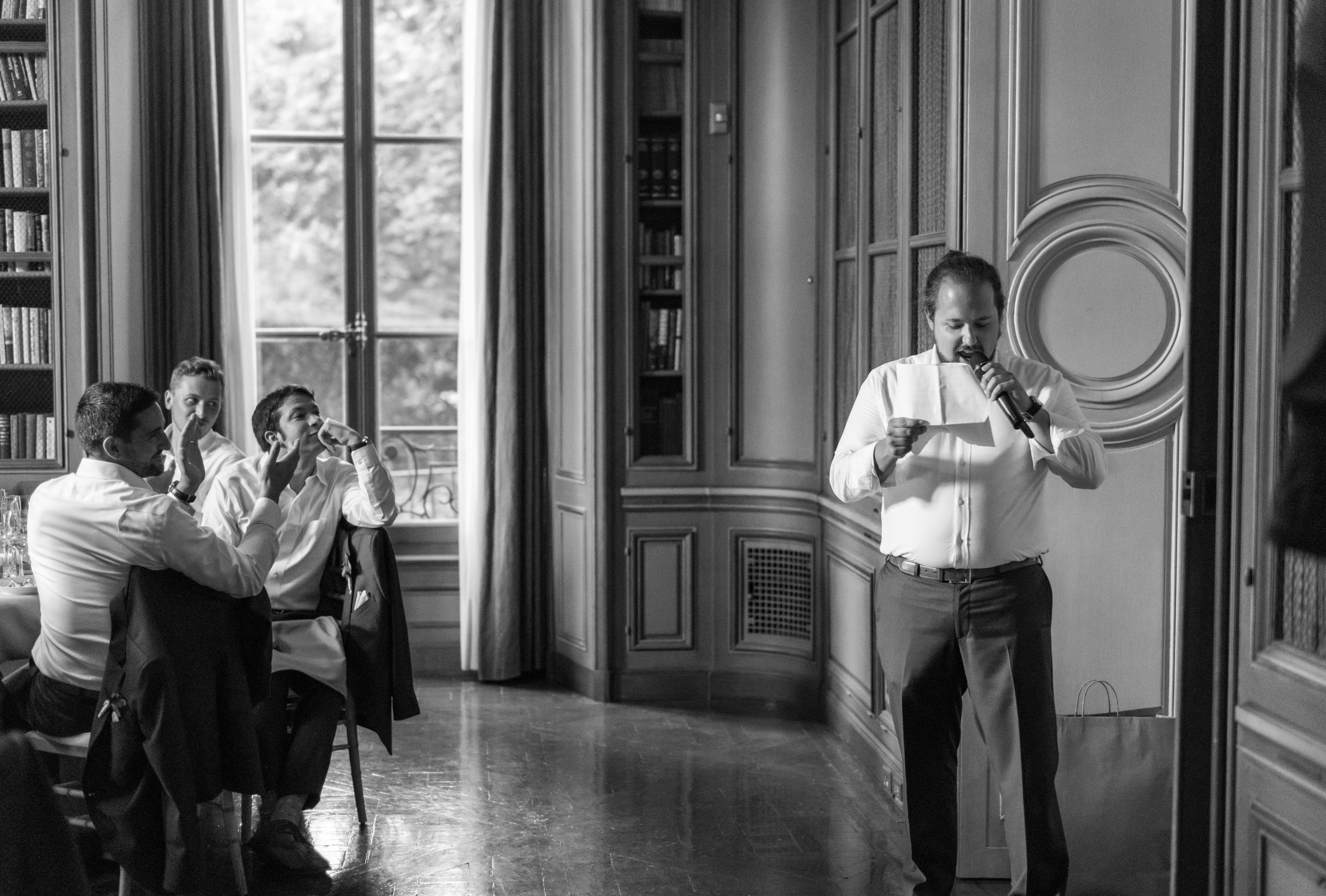 Groomsmen toast in the green library at meridian house wedding