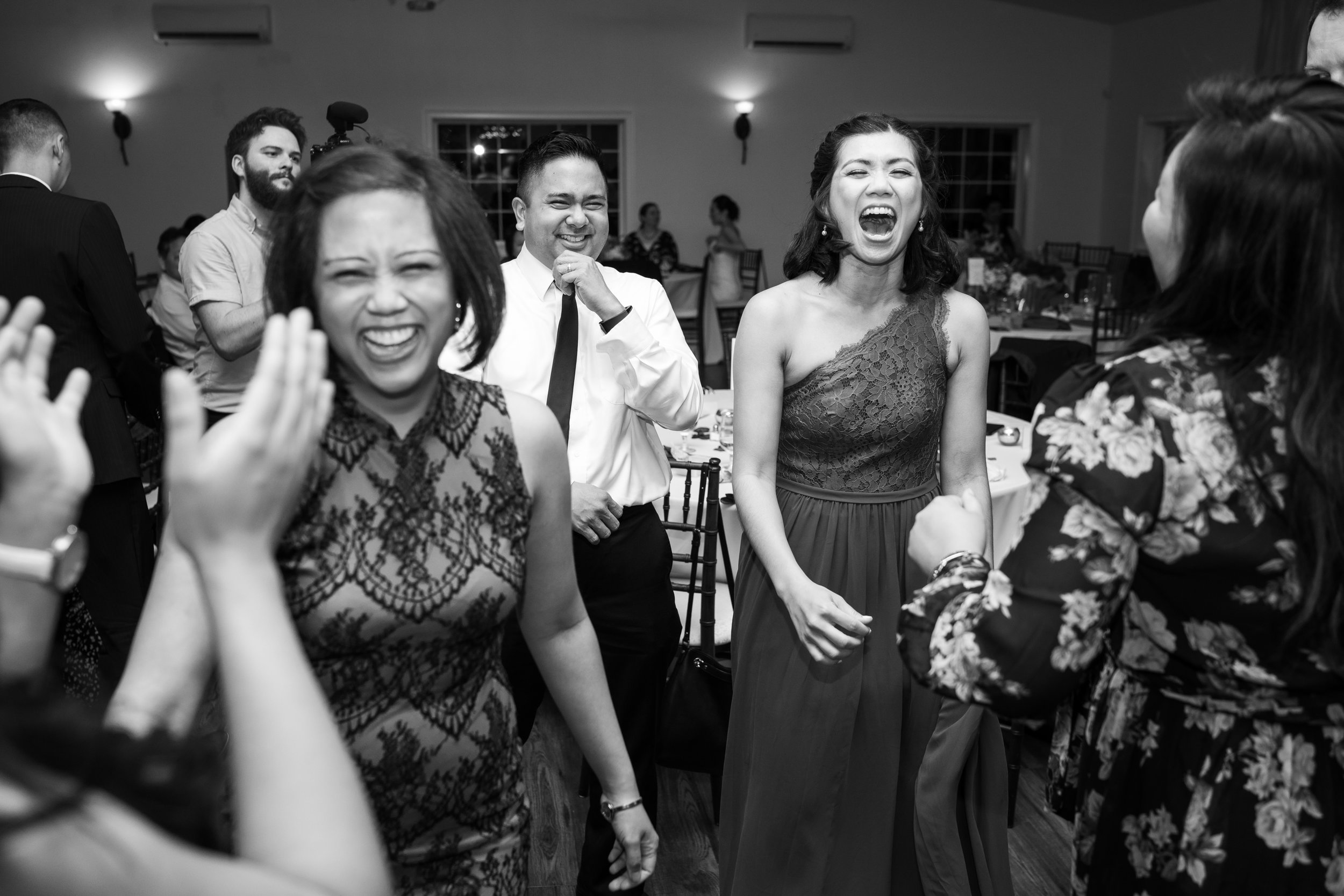 Guests laughing at a wedding at Harvest House Lost Creek Winery
