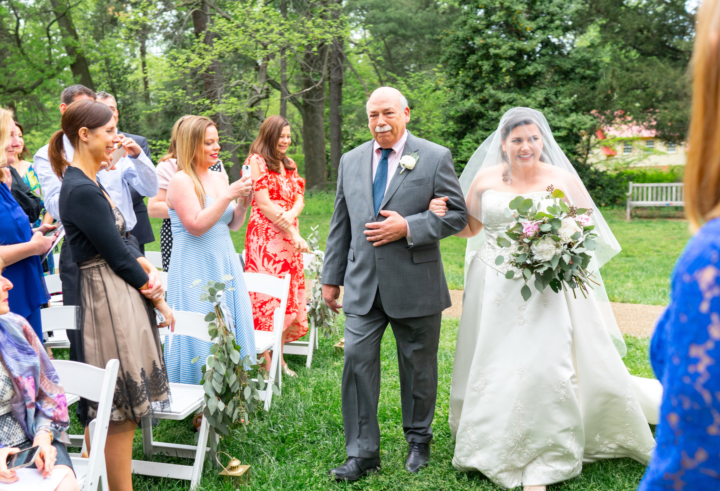 Bride and her father walking down the aisle at Hendry House wedding