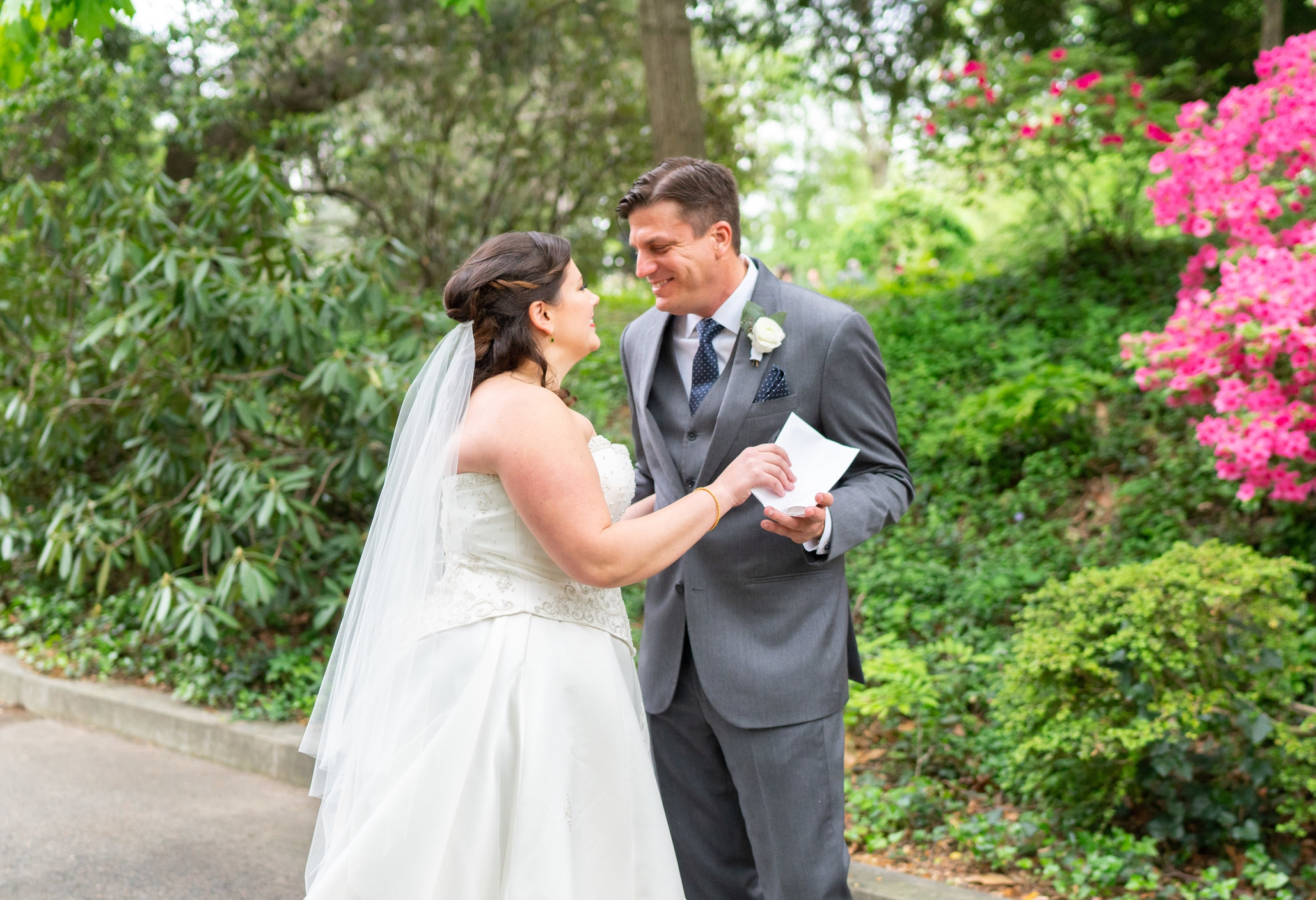 Bride giving her groom a letter during their first look at Hendry House