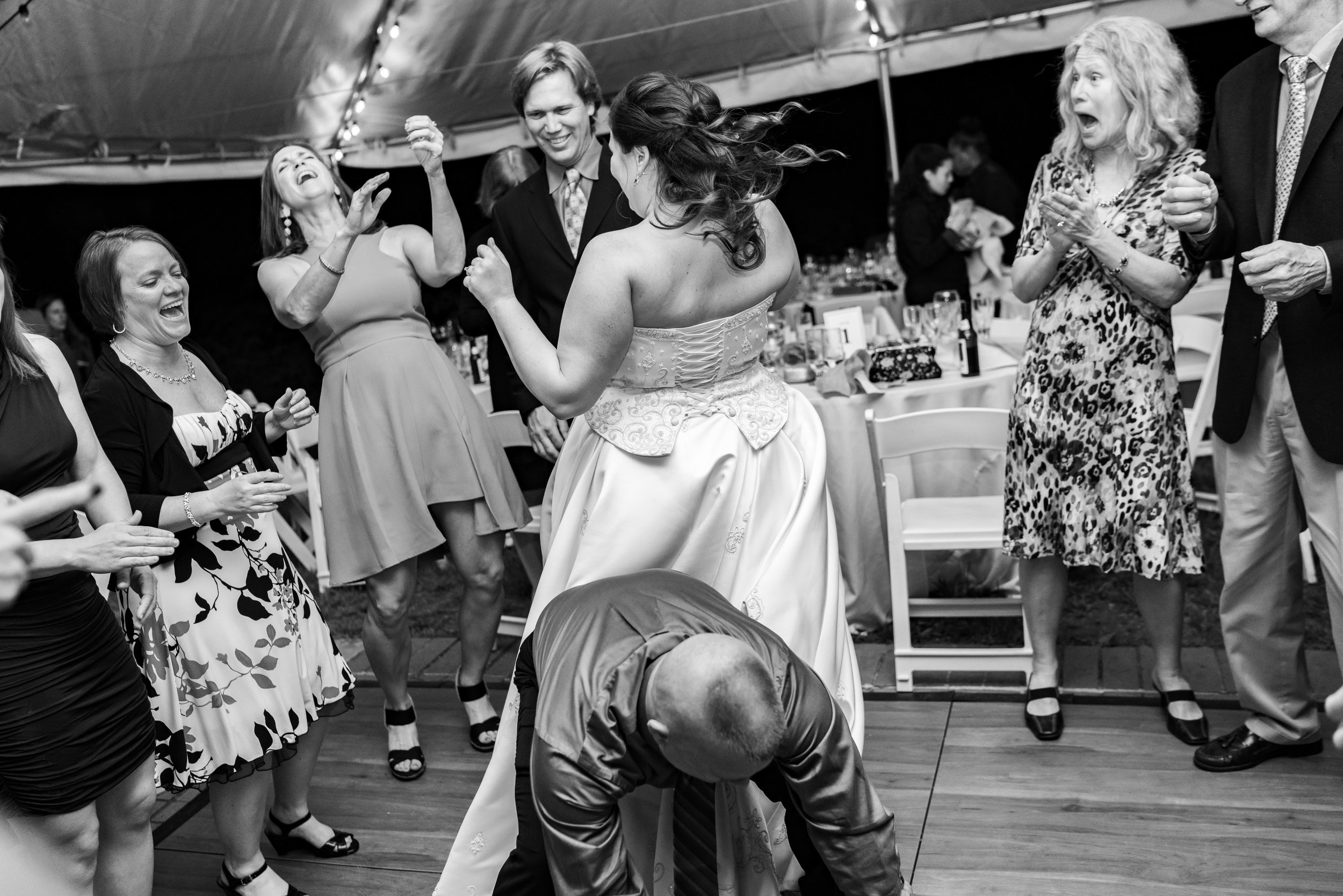 Amazing black and white photo of guests and bride dancing crazy on the dance floor at Hendry House