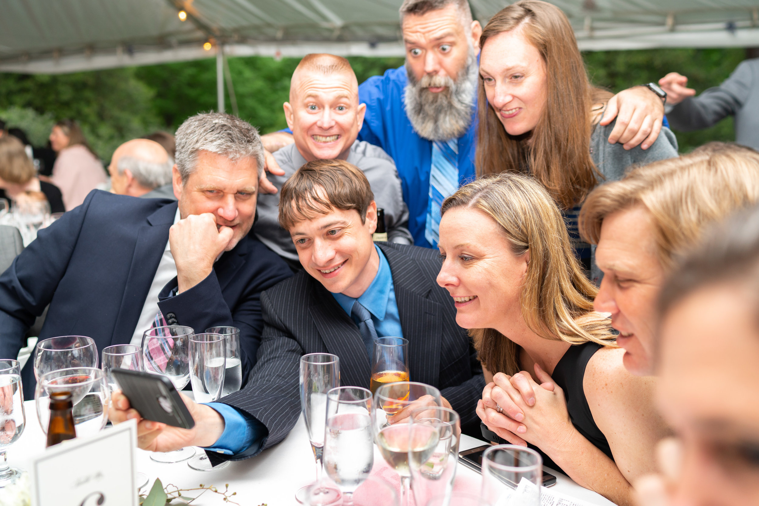 Guests and groom watching the Kentucky Derby at Hendry House summer wedding