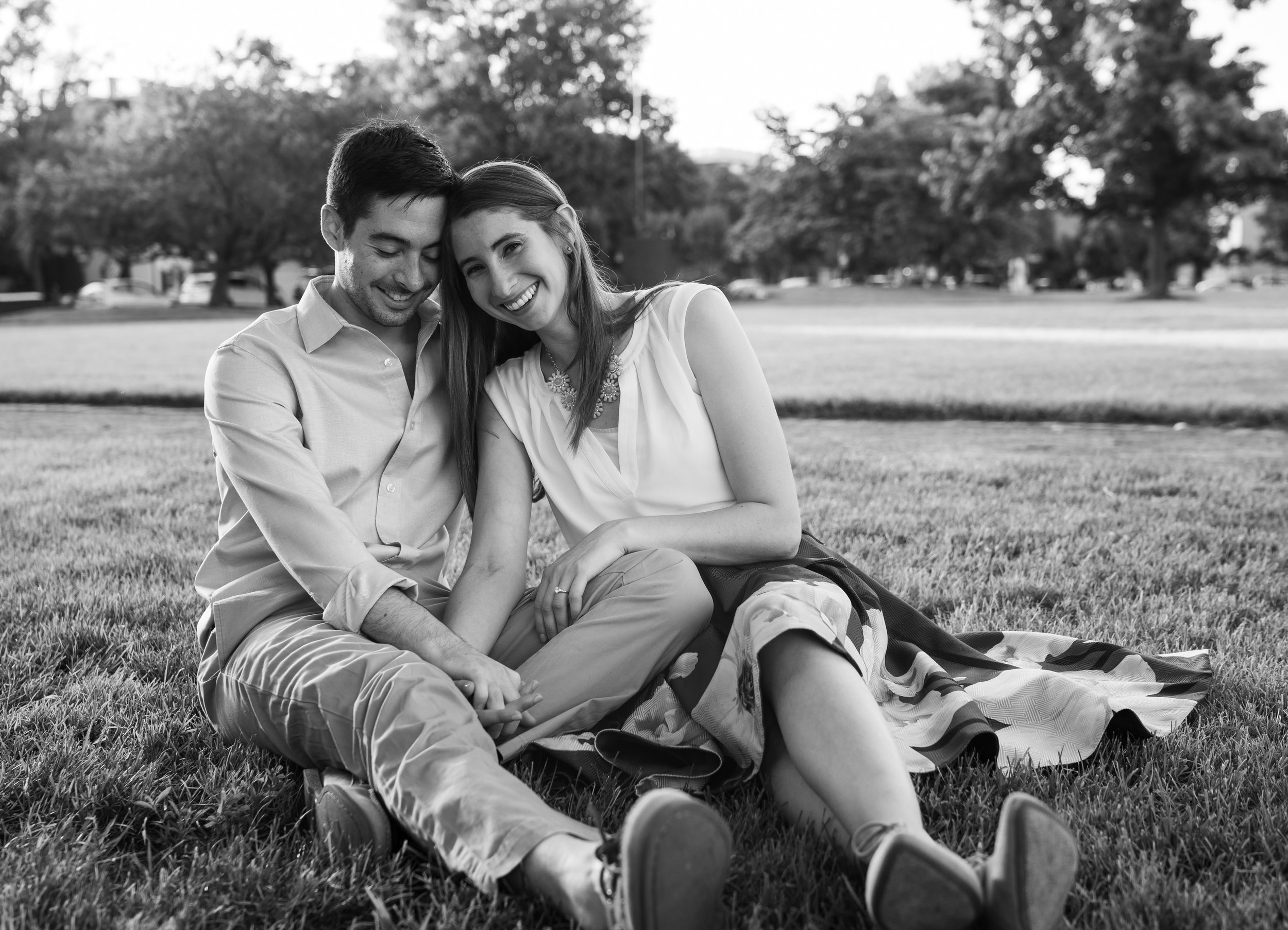 Alexandria waterfront engagement session in the summer on the grass