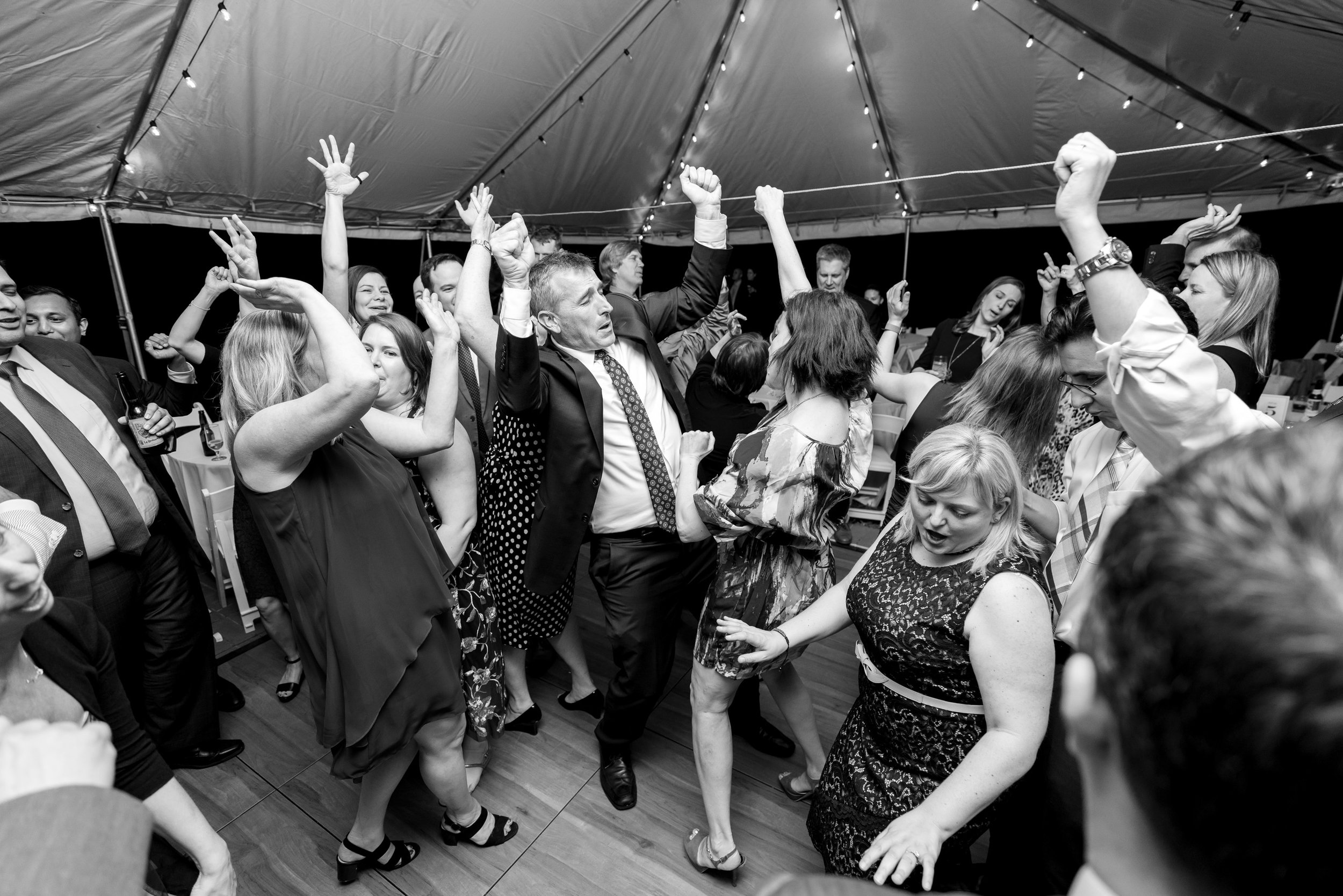 Guests having an amazing time at tented wedding reception at Hendry House