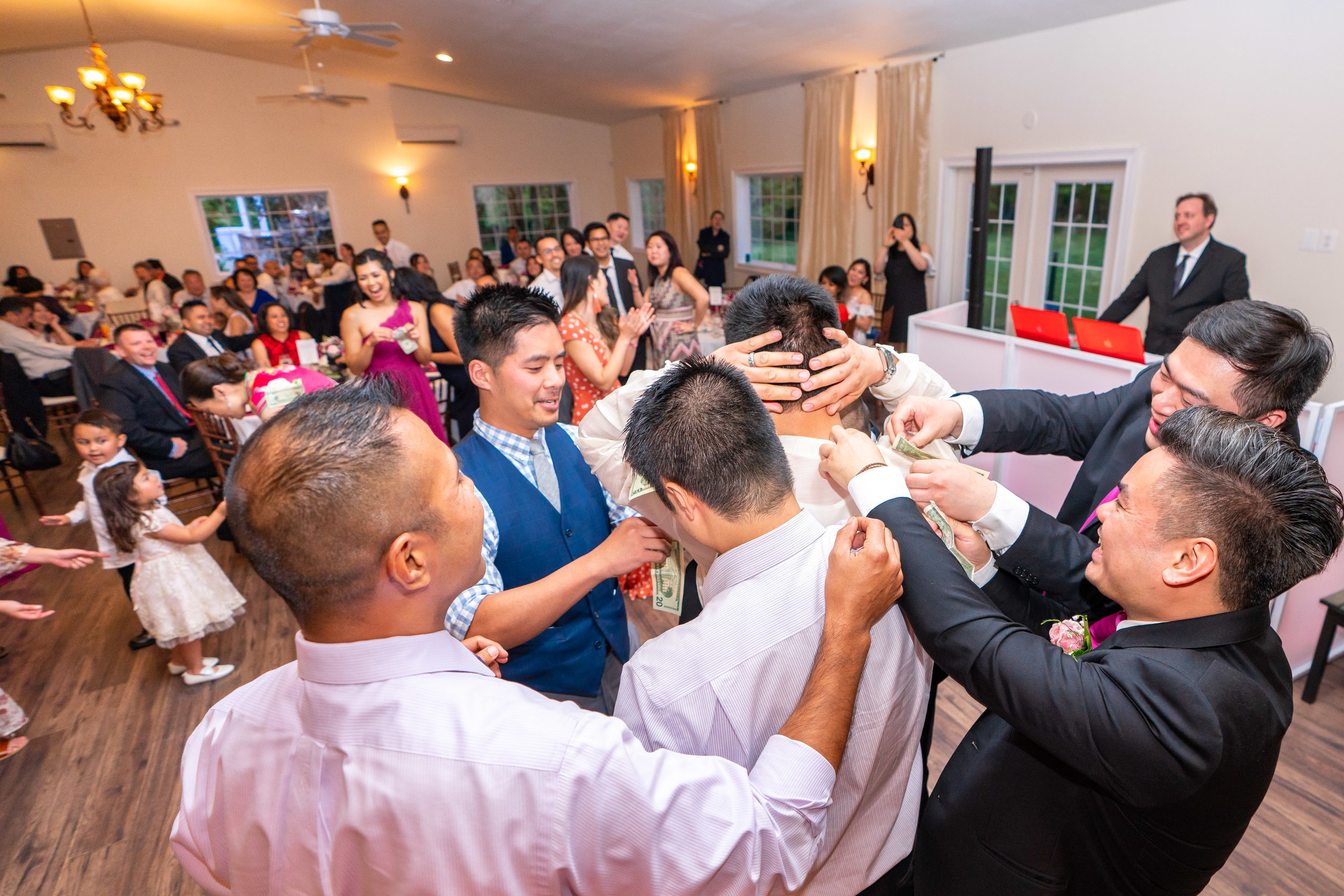 Groomsmen at Lost Creek Winery wedding money dance