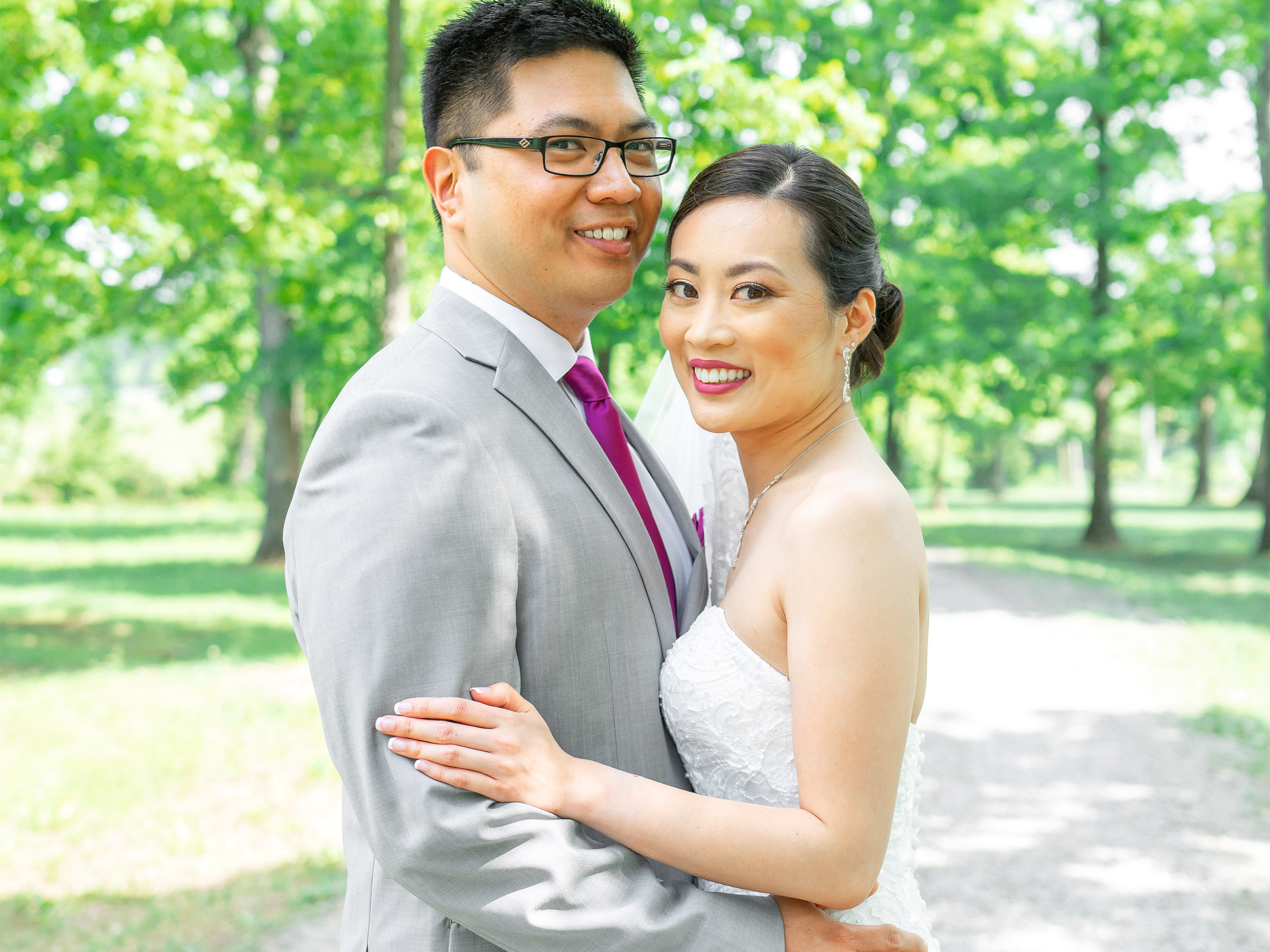 Bride and groom at Harvest House at Lost Creek gravel pathway in trees
