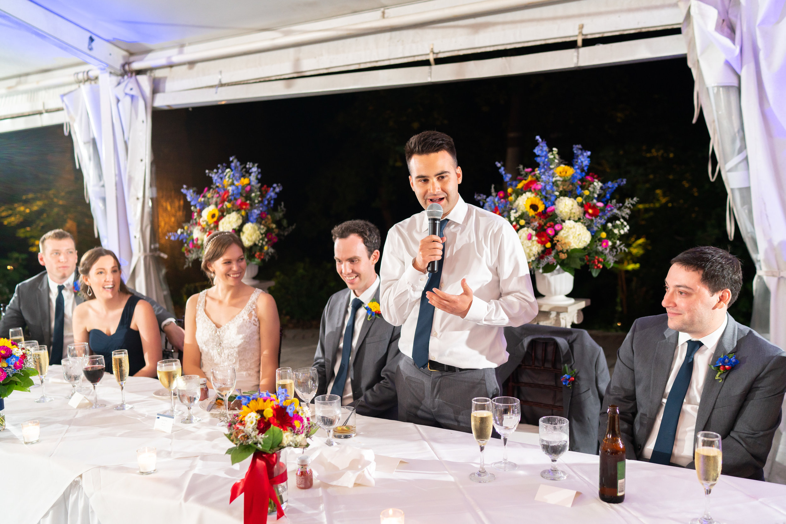 Toasts under a white tent at Elkridge Furnace Inn wedding reception photos