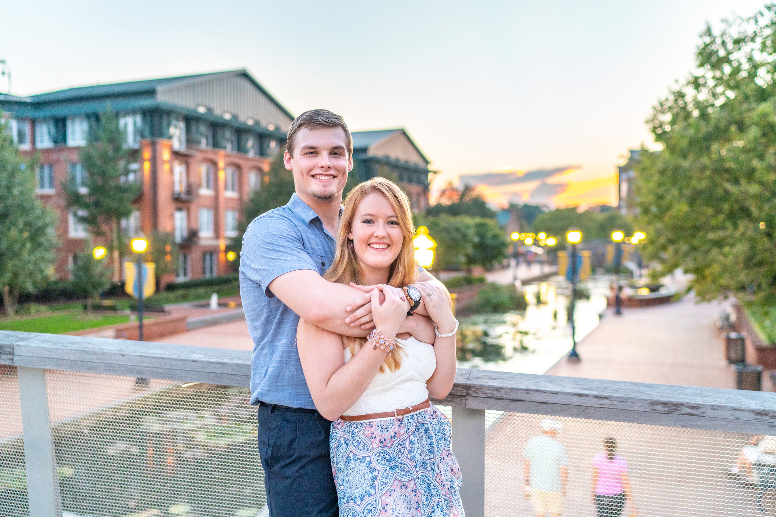 Bride and groom at sunset engagement photo session downtown Frederick riverwalk