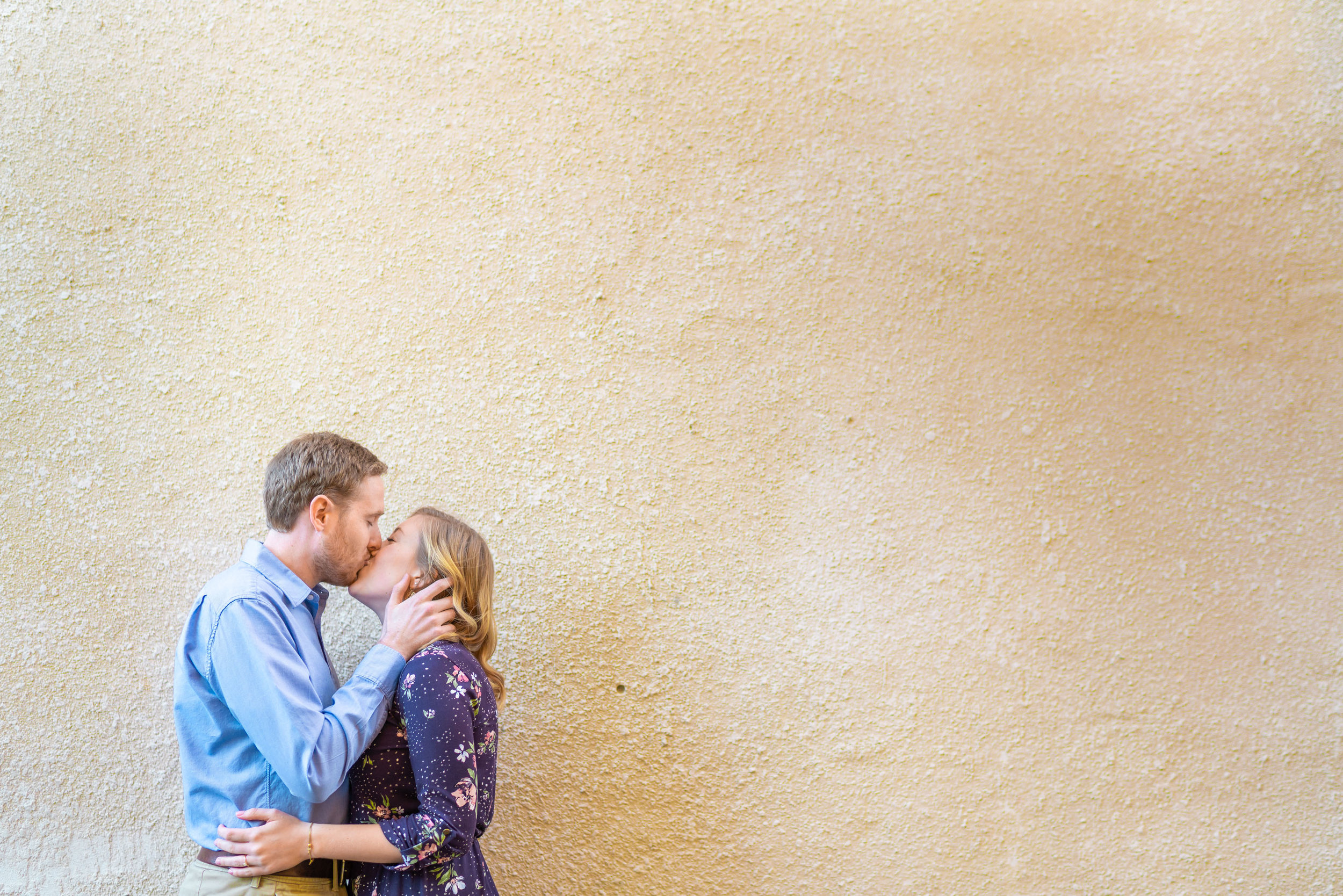 Bride and groom kiss during engagement session at Federal Hill in Baltimore