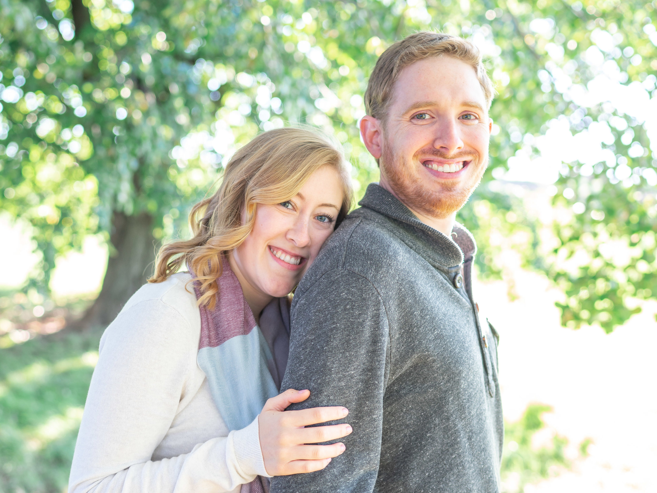 Bride and groom under tree at Fort McHenry engagement session